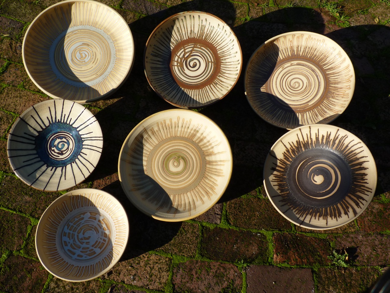 Large ceramic bowls by Konstanze Harms in the slanted evening sun.