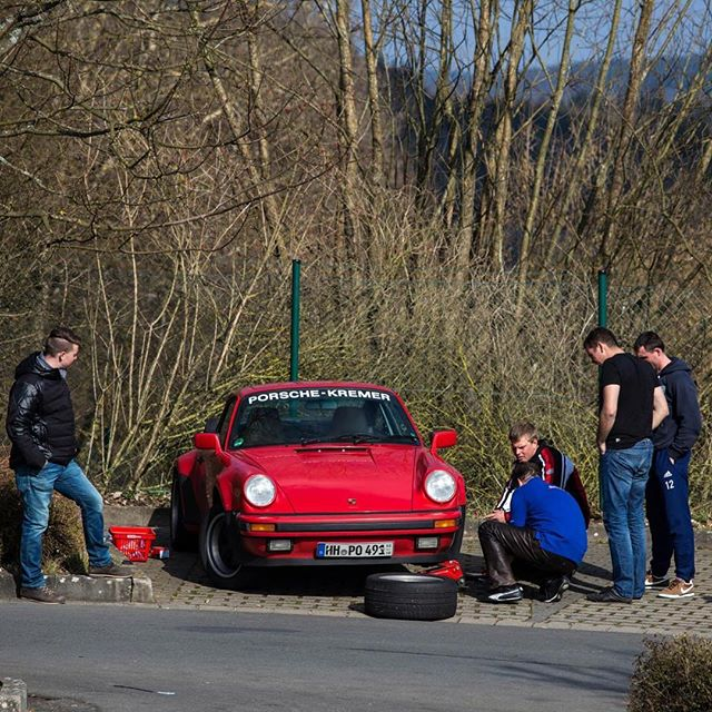 How car work gets done when your friends come over to help. This 911 was trying to get back out and enjoy himself on the Nordschleife.  #porsche #911 #nurburgring #kremer #guardsred #work #trackday #itsadriverbro