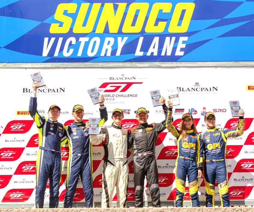 Photo: Sean Krinik  - All 4 ST Racing drivers on podium.  Left - 2nd Place ( Jon Miller / Harry Gottsacker )  Right - 3rd Place ( Samantha Tan / Jason Wolfe )