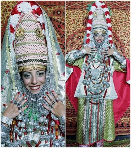 """""""Because the wedding ceremony lasts for three days, the bride will change three different outfits. Beforehand, during the cleansing and beauty treatments, the brides have to wear traditional green dresses; the next day, as they attend the hair dressers, they wear a red dress with gold strings. Every time they are in public, they need to wear different gold veils and gold jewelry. They have to wear as many as possible (must be really heavy!), actually, they have to wear every single piece of gold jewelry they possess. On their wedding day, the brides from Yemen usually wear gold and white veils and a marvelous and spectacular headpiece."""""""