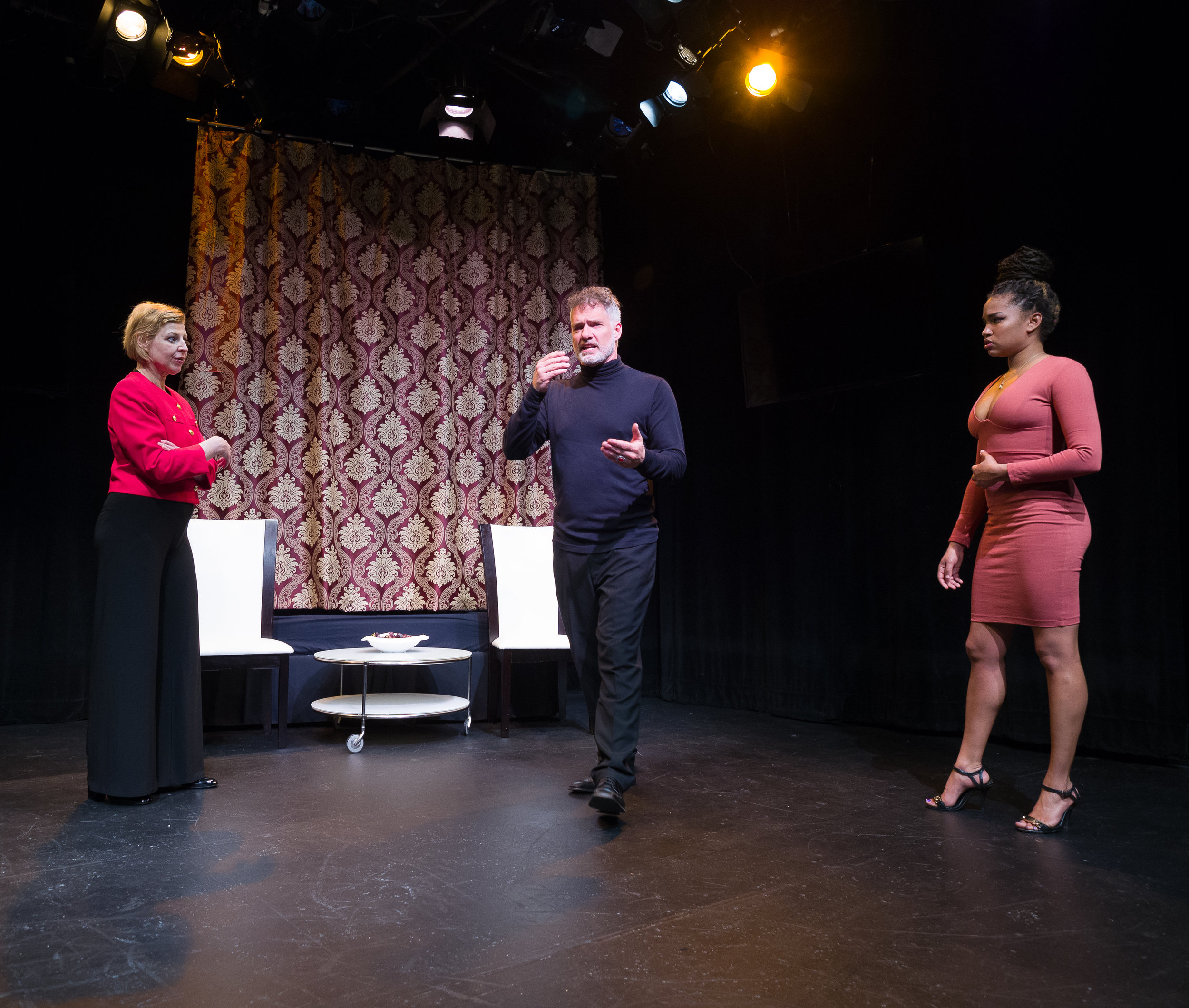 Left to Right: Françoise Balthazar as Lucrezia Borgia; Paul Hopkins as Alfonso D'Este; Chelsea Russell as Angela Di Ghilini. Set and costumes by Jan Venus; lighting design by Waleed Ansari. Photography by Rene Stakenborg.