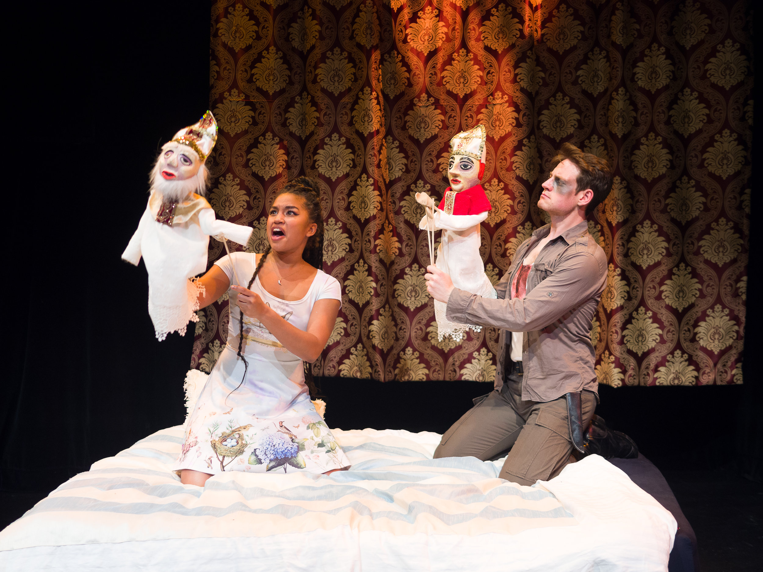 Left to Right: Dewey Stewart as Giovanni; Russell as Angela Di Ghilini. Set, costumes and puppets by Jan Venus; lighting design by Waleed Ansari. Photography by Rene Stakenborg.