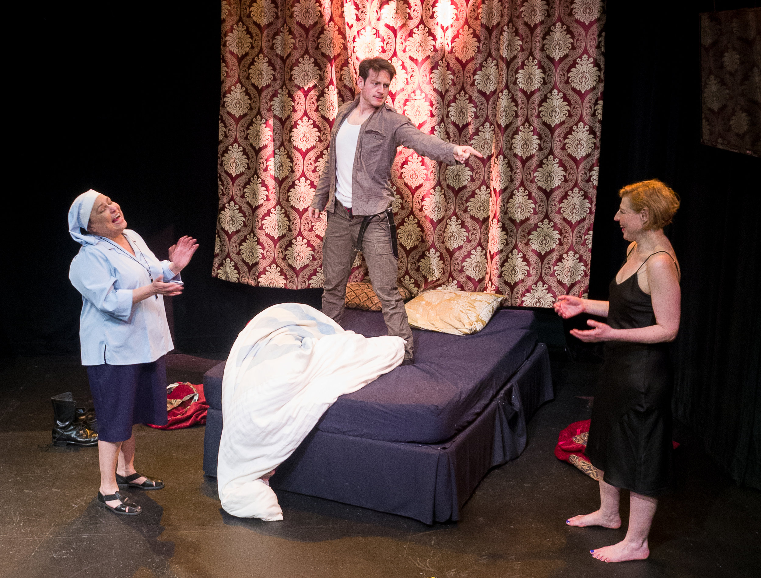 Left to Right: Martha Chaves as Sister Bibianna; Dewey Stewart as Giovanni; Françoise Balthazar as Lucrezia Borgia. Set and costumes by Jan Venus; lighting design by Waleed Ansari. Photography by Rene Stakenborg.