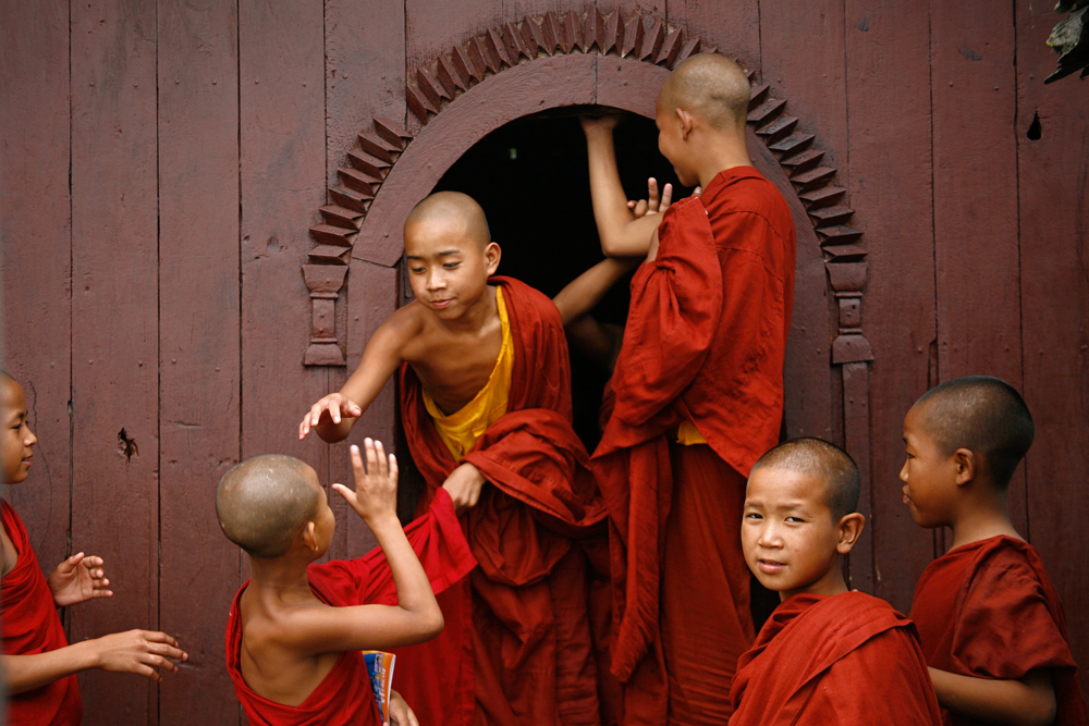 Shan monk novices play outside their village near Heho, Myanmar.