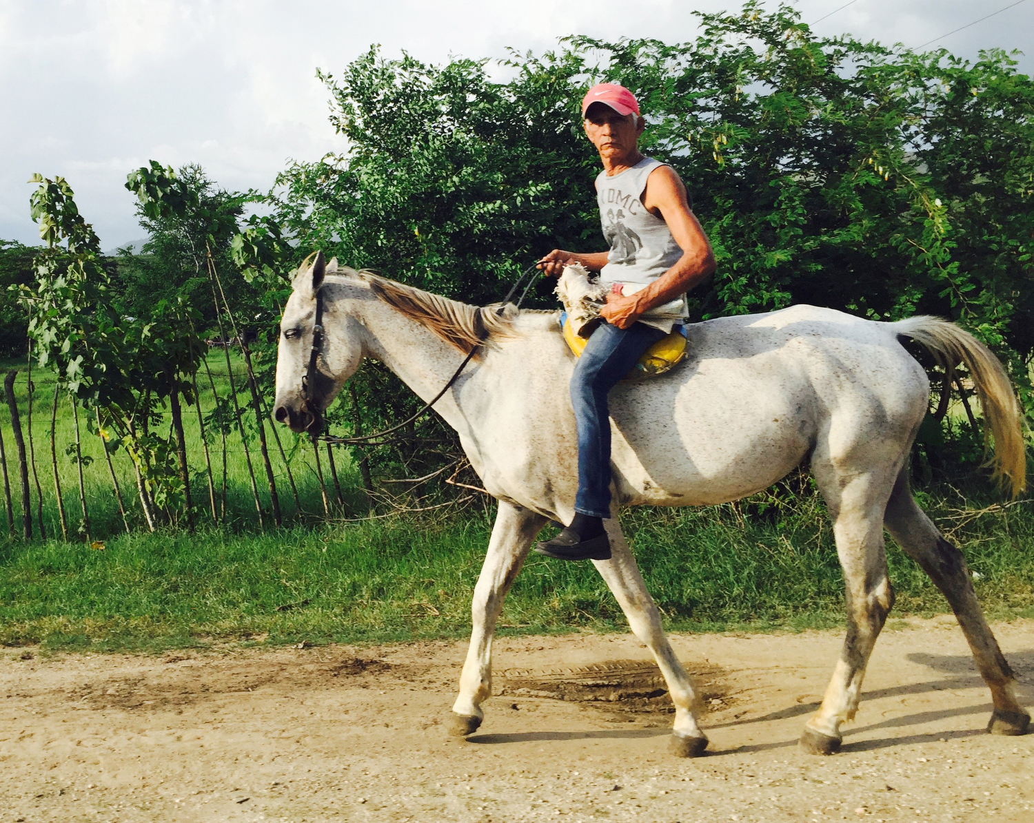 A man rides horse back near the small village towns in the Sierra Maestra mountain region outside of Santiago de Cuba. Many still ride horse carriages in the city to work.