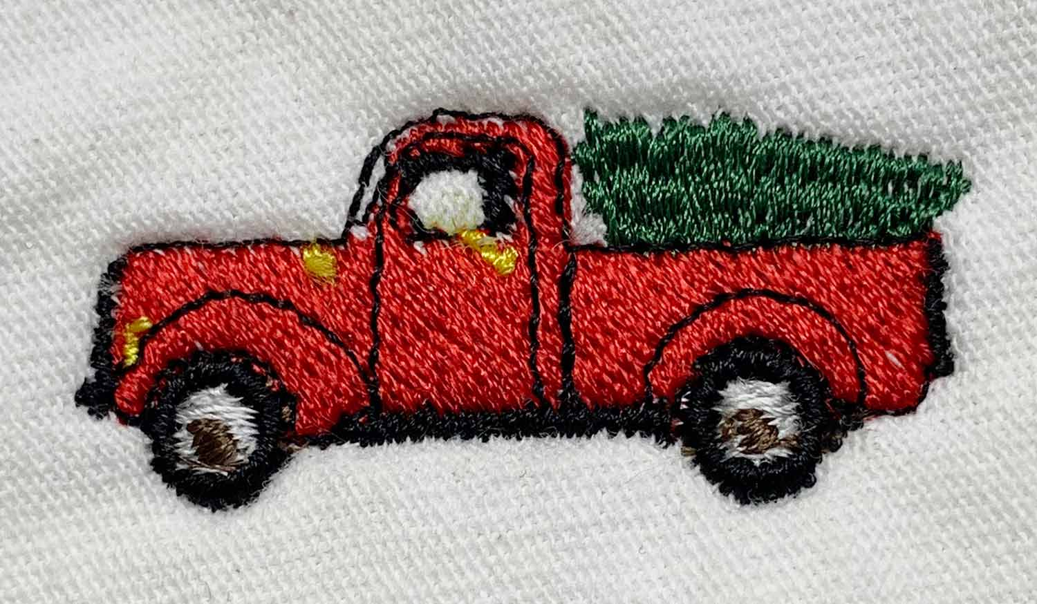 KYC_OLD-TRUCK-WITH-CHRISTMAS-TREE-IN-BACK_web.jpg