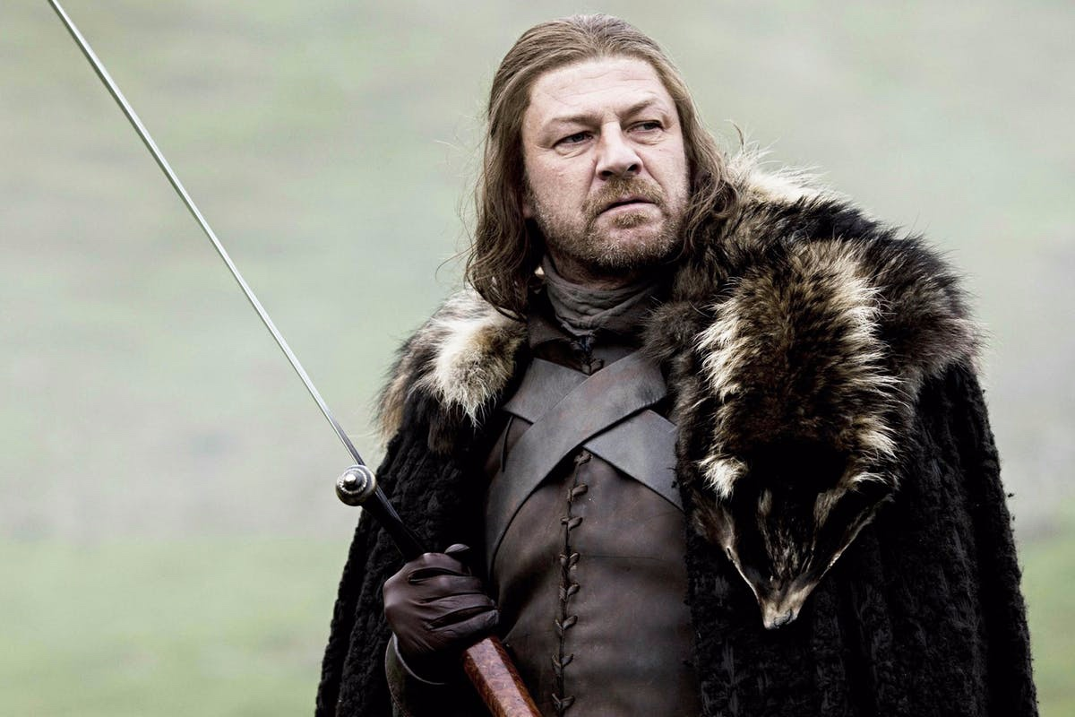 "NIKKI - Eddard ""Ned"" Stark (Game of Thrones) – Lord Ned Stark, the patriarch of House Stark and the King in the North (of Winterfell), faced an un-timely death at the end of S1 via beheading by the worse possible person: King Joffrey Baratheon, the young snot-nosed brat who ascended to the Iron Throne after the poisoning/death by boar of his father Robert, coordinated by his mother, Cersei Lannister. Ned was legendary; a honorable character that every man wants to become and every woman wants to love. His downfall came as a result of him having mercy, by trying to save lives and we miss him because he left a huge impact on us through his 5 children. His death was heart-breaking and tragic because he died for doing the right thing and standing up for his beliefs -- and it was a total shock. It was a sad reminder that sometimes in fact, nice guys do finish last."