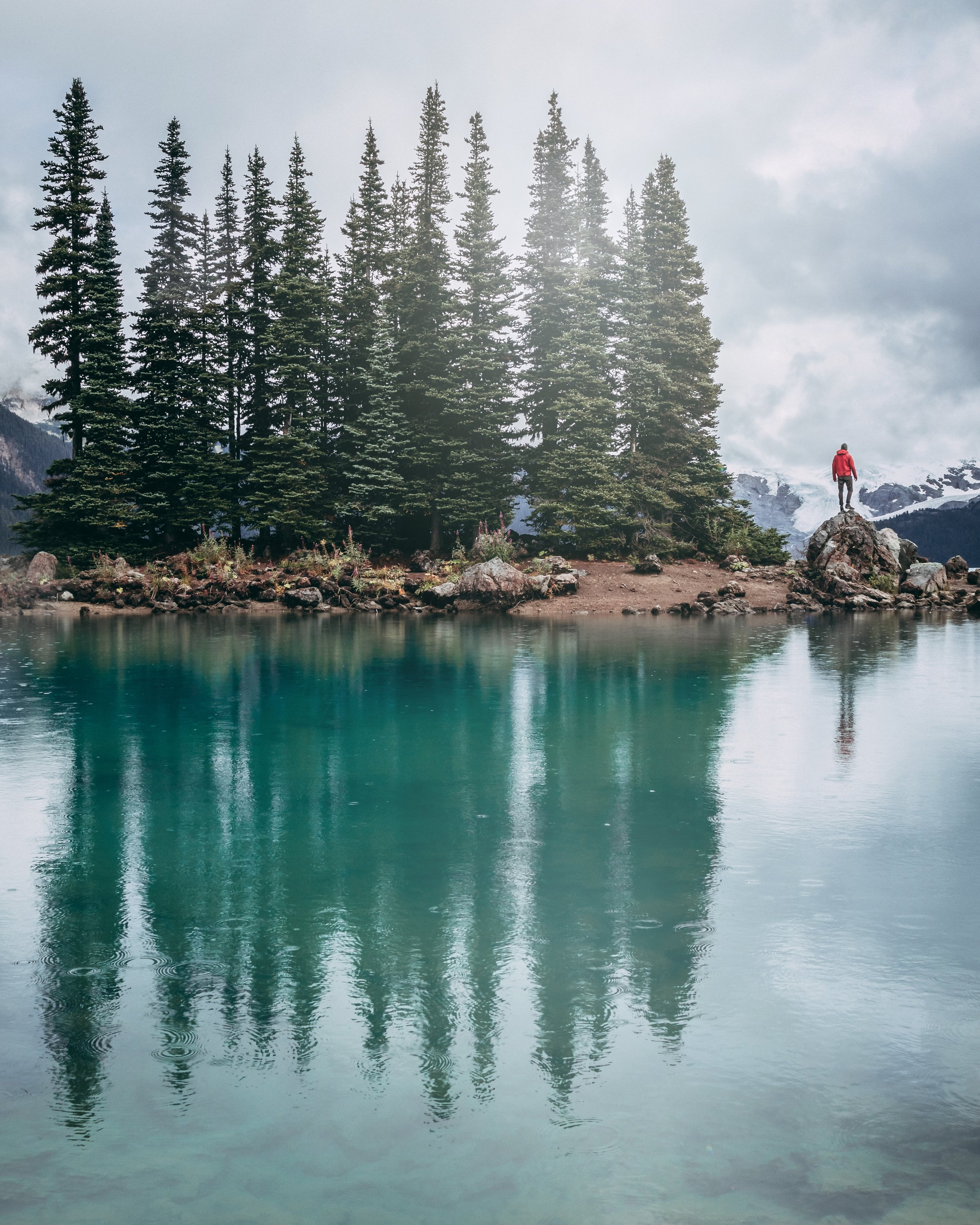 Person-standing-on-log-at-Garibaldi-Lake