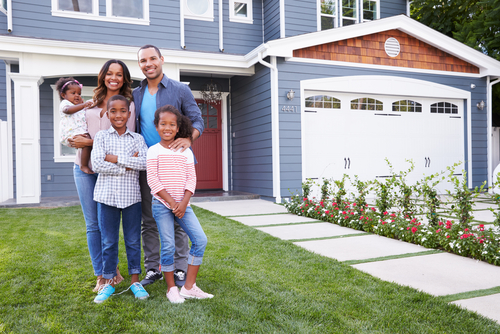 stock-photo-happy-black-family-standing-outside-their-house-401694988.jpg