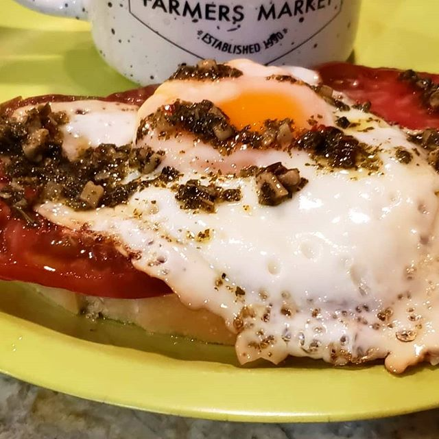 Sprout and Blossom's heirloom tomatoes, farm fresh egg, River Wave Foods Chimichurri on top of Columbia sourdough toast . Farmer's Market Breakfast.Yum!