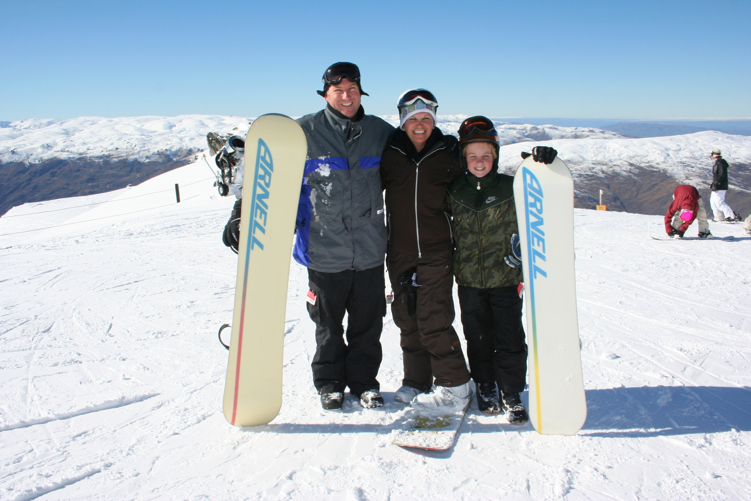 Charles and his family on a snowboard trip in new zealand.