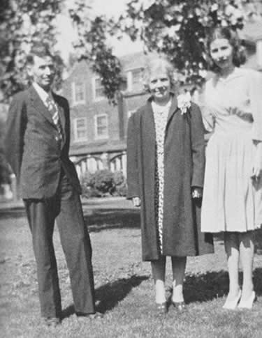 Amy with her parents, at Grinnell, 1941