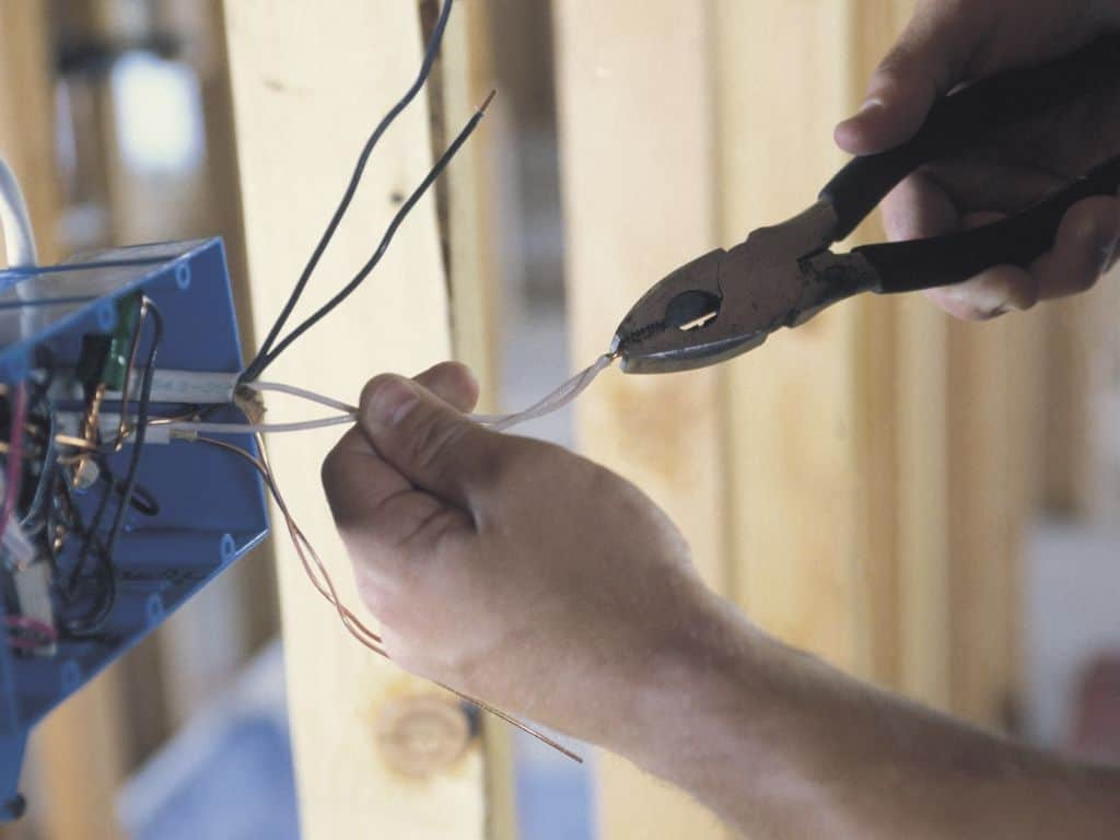 Man rewiring an electrical panel