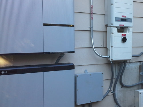 solar edge battery backup system mounted on side of a home