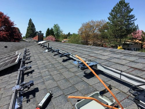 ongoing solar installation on a roof