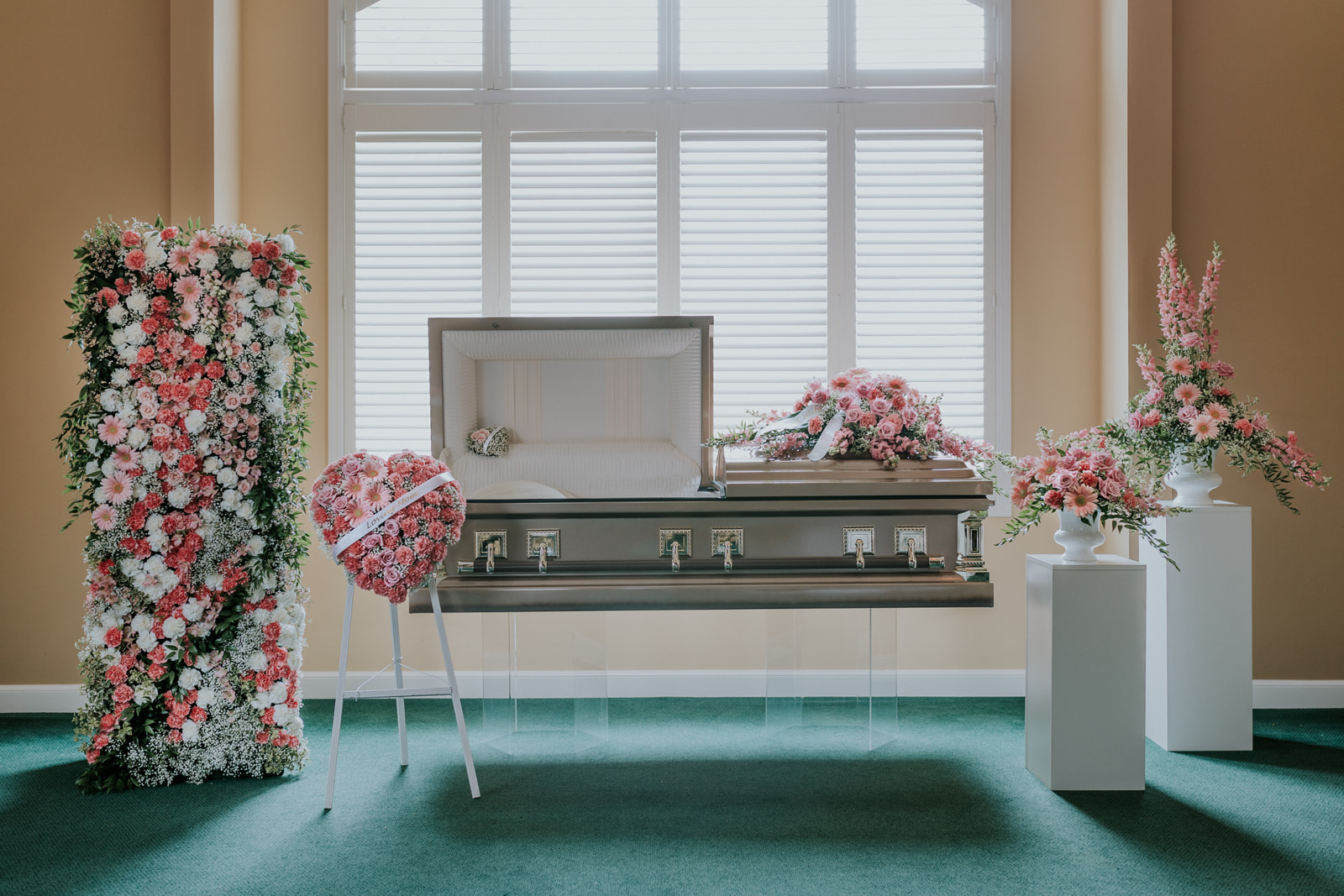 The Pink Twilight Collection is a lush garden with shades of pinks with white. The pieces are designed using pink roses, gerbera, and snapdragons accented by carnations, alstroemeria, and baby's breath.