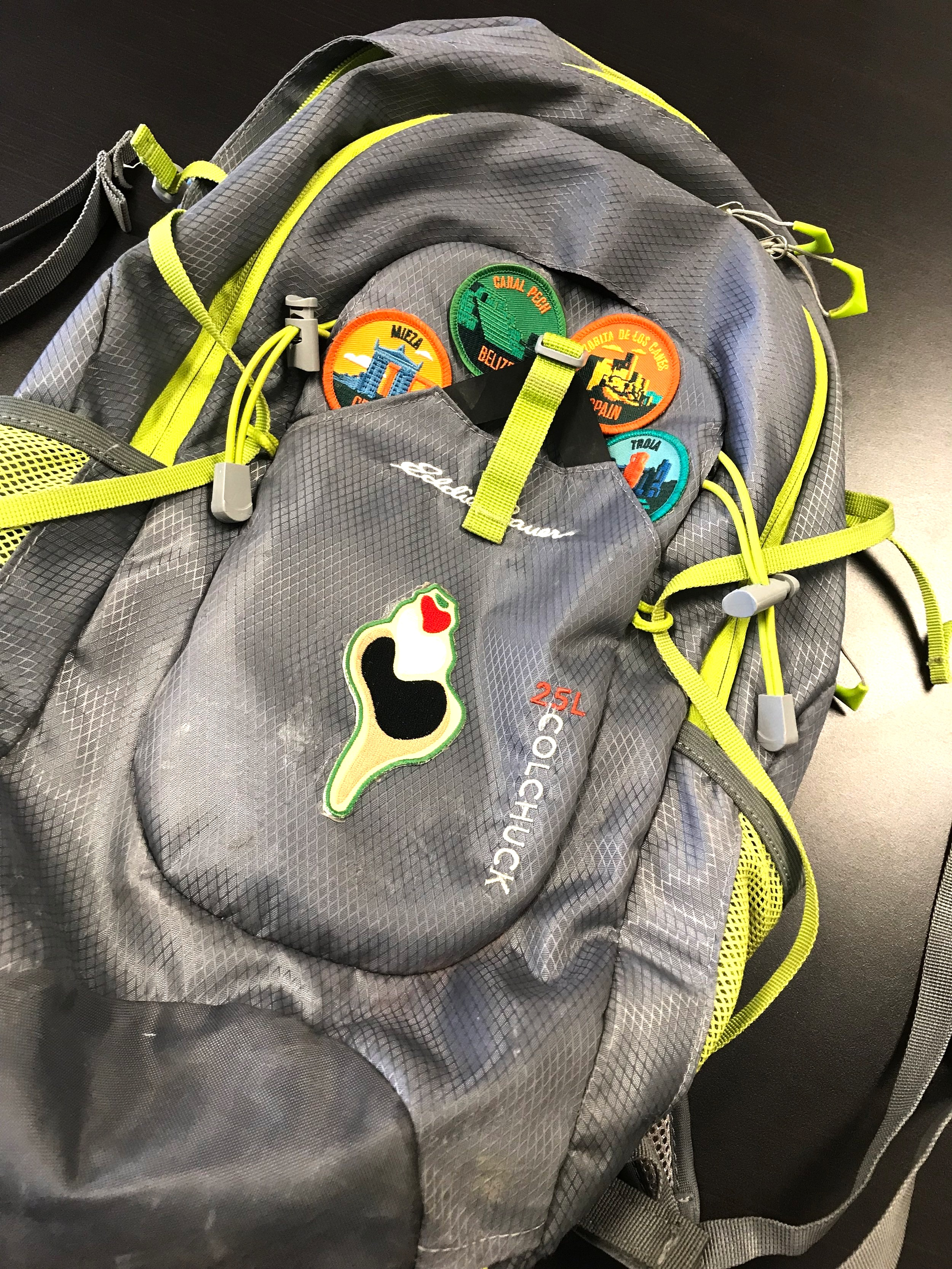 The proud owner of this hydration pack has earned patches at all four project sites.