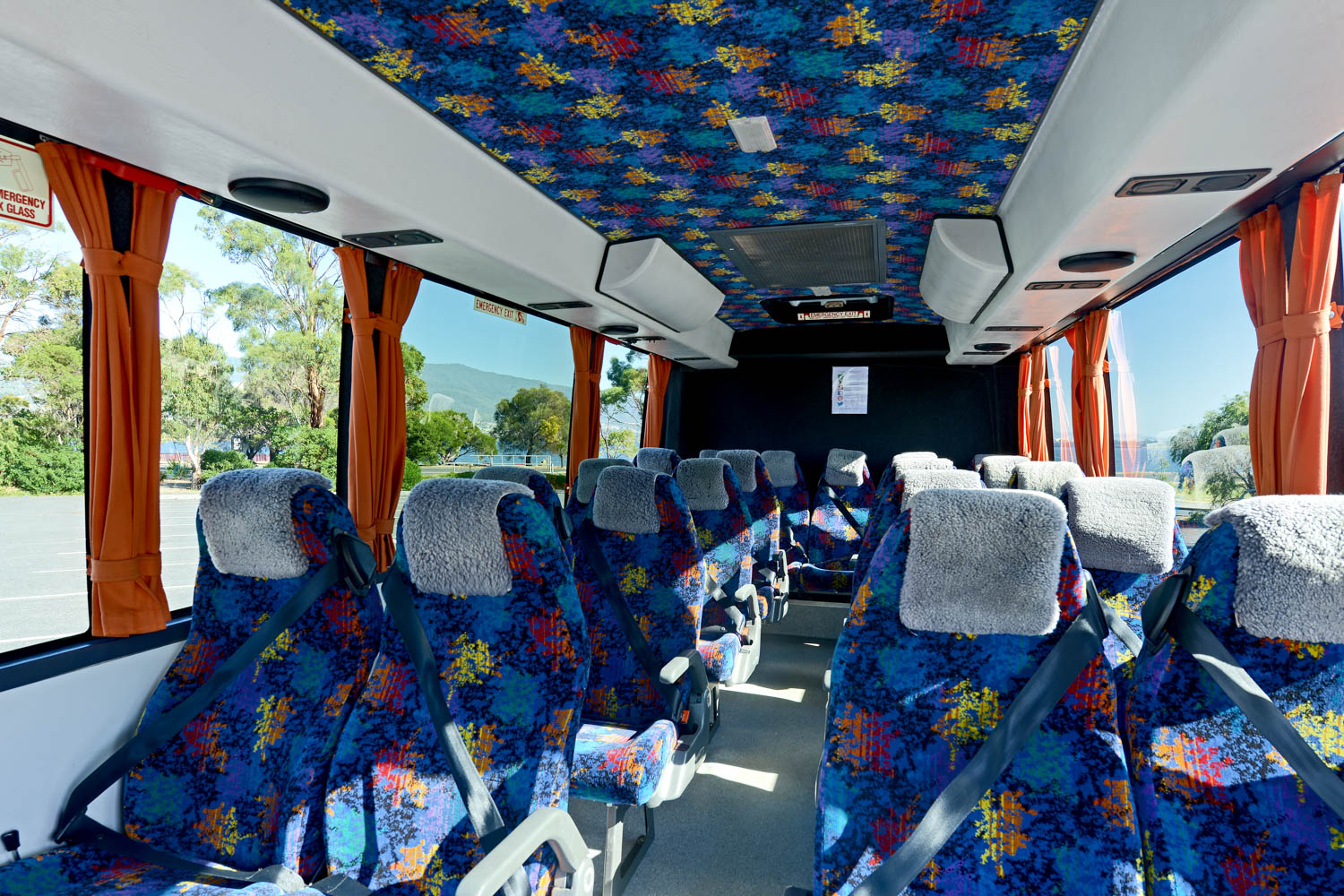 Our luxury - spacious seating & foot areas, cloth reclining seats & curtains -