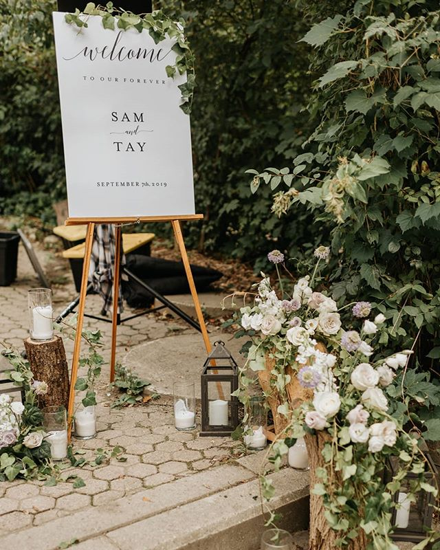 A pretty little scene complete with logs, candles, ivy, lanterns and of course... flowers! We kept the welcome sign simple and clean. Wish I could show you the glow of the candles at dusk... so romantic ✨ . . . . Photo by @saramonikaphoto  Venue @kortright1982  Planning by @laceandbirch  Videography by @aroymotion . . #torontoflorist #flowersofinstagram #floraldesign #floraldecor #bloomsbyspring #gtaweddingflorist #bloomsbyspringfloral #justsaidyes #weddingflorist #weddingdecor #bridaldetails #floral #welcomesign #weddingwelcomesign #romantic #torontowedding #torontoengagement
