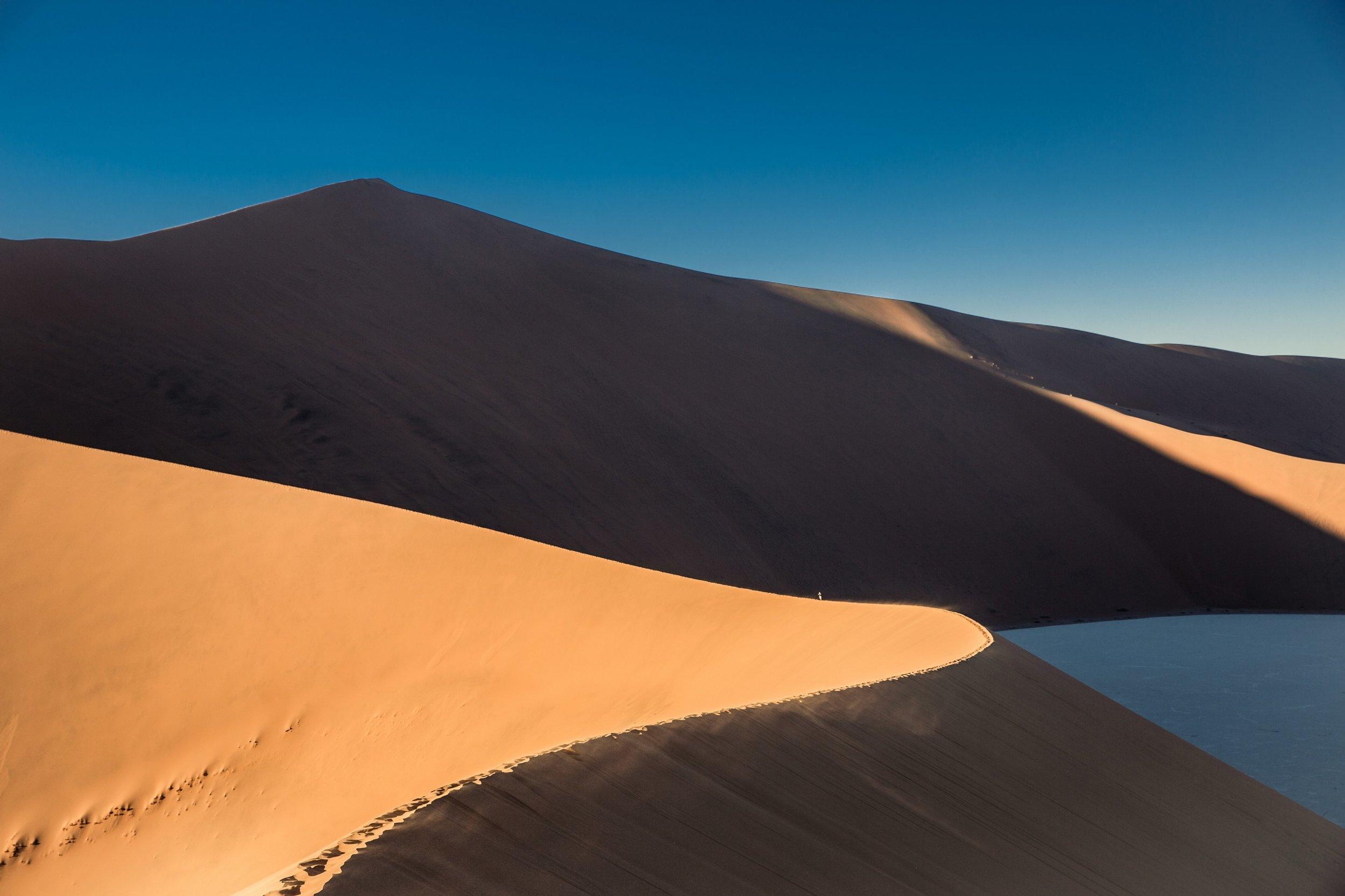 42278-sand-dunes-and-ridges-in-the-desert-at-sundown___sloping-sand.jpg