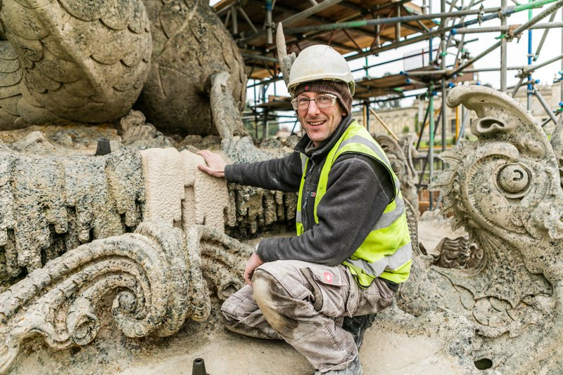Image credit: a skilled mason repairs stonework paid for by The Once and Future Fund /  English Heritage