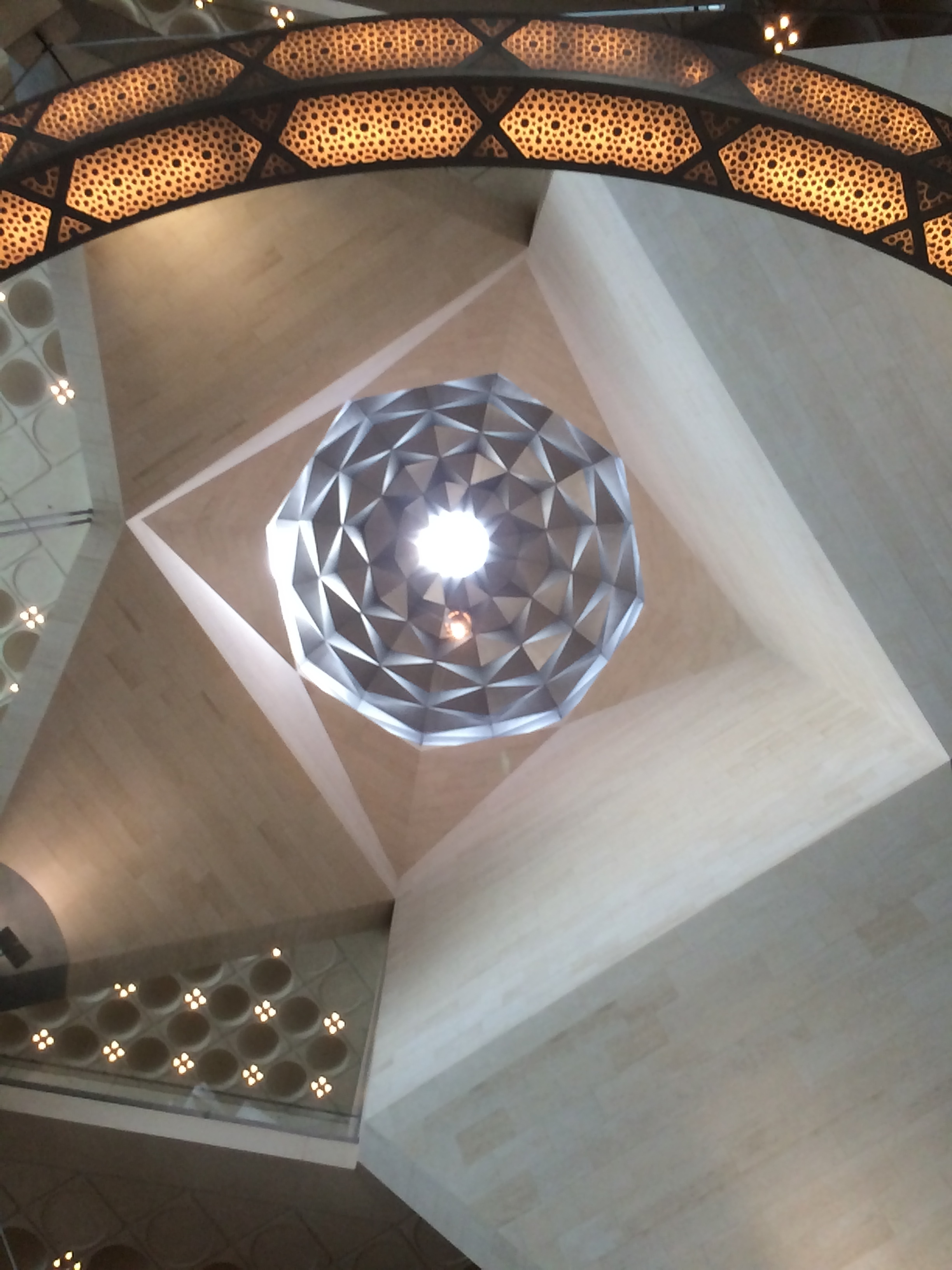 Looking up at the ceiling inside the Museum of Islamic Art.