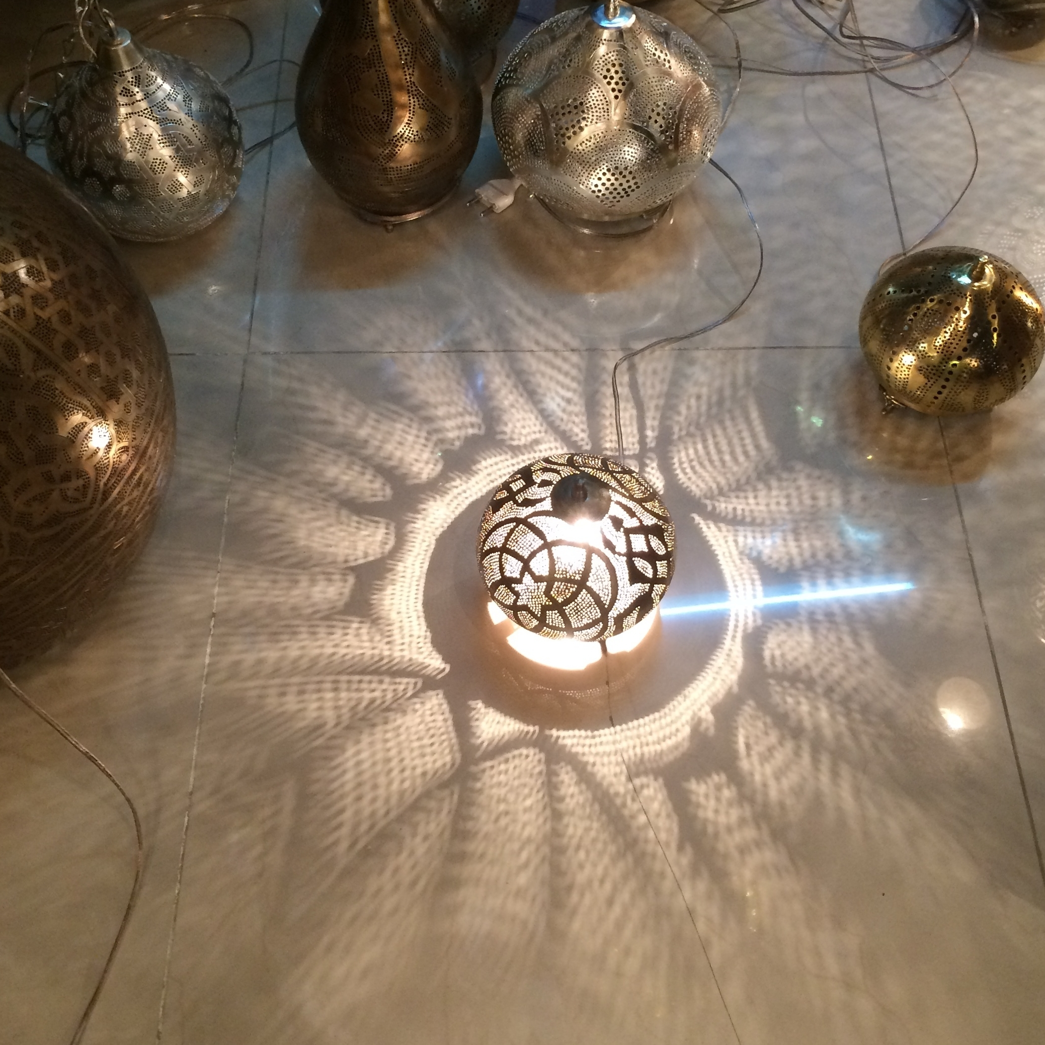 Hand punched metal lamps.