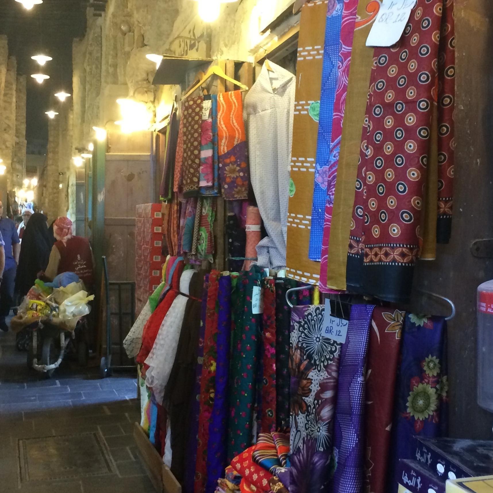One of several alleyways in Souq Waqif full of beautiful textiles.