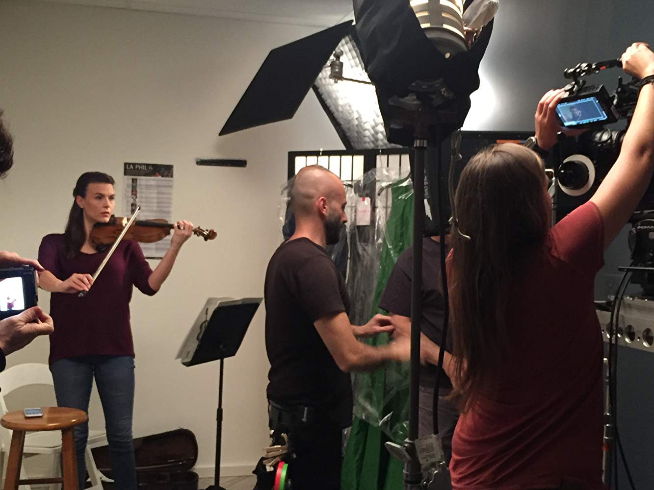 Set up for a scene taking place in a musician's practice room.