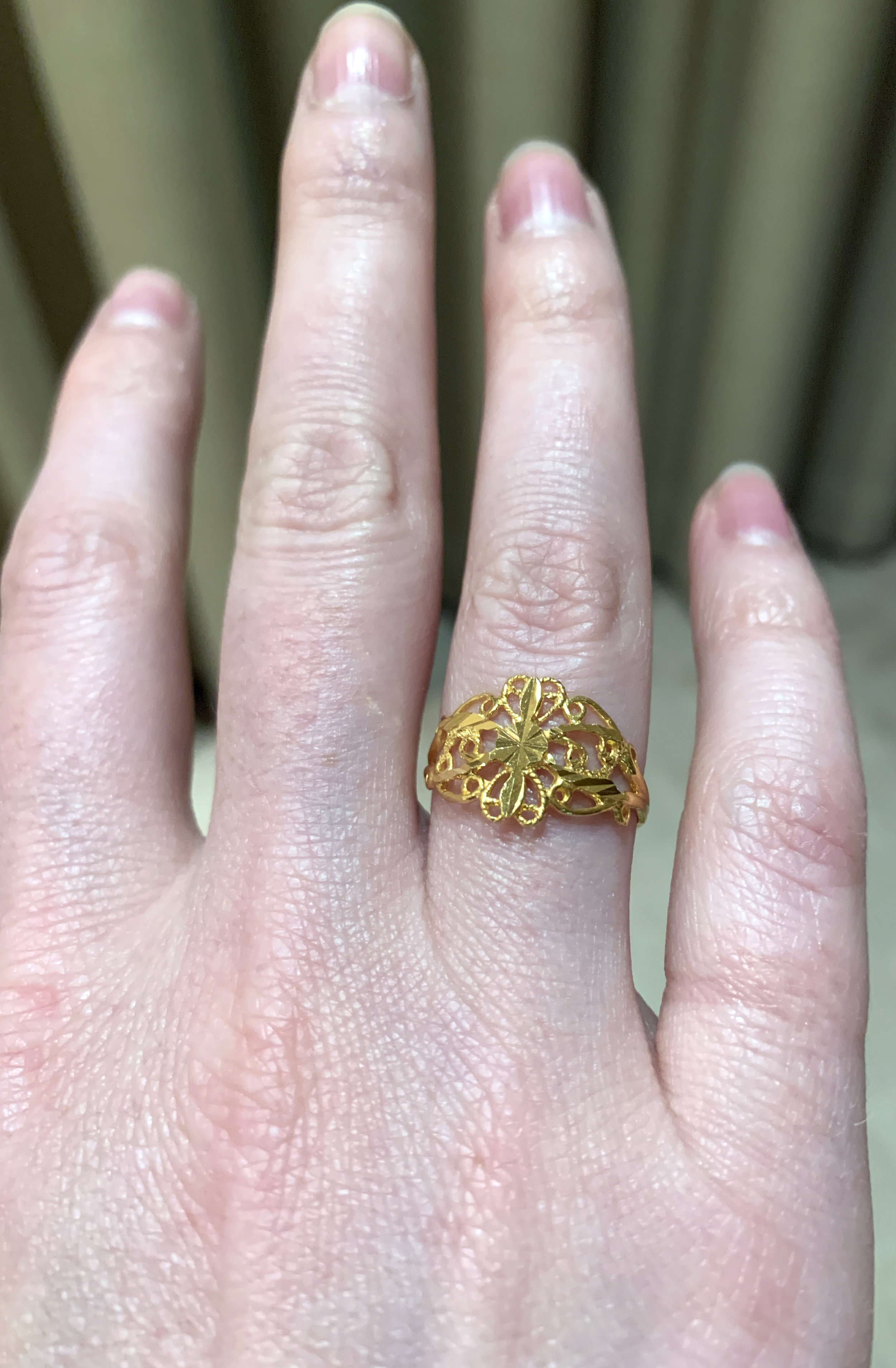 The intricate ring I splurged on.