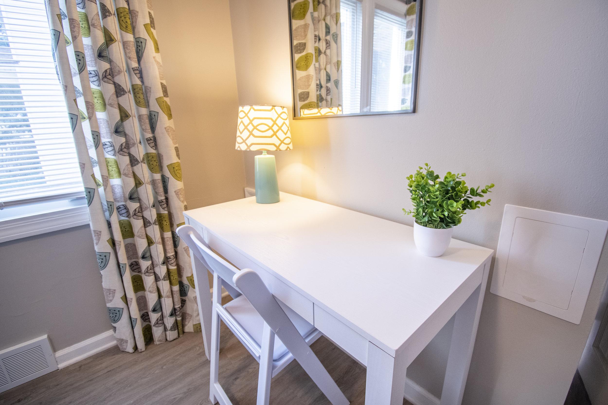 Optional desk/vanity for guests.