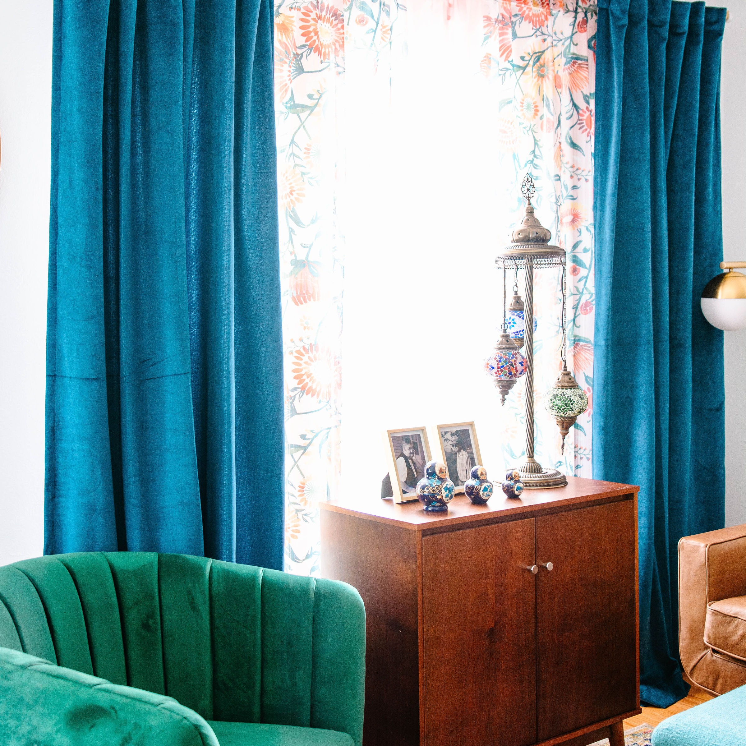 I paired Target's Sheer Opalhouse curtains with this blue velvet curtain in my living room. It makes for a dramatic effect. (Photo by: m.mcgdesigns)
