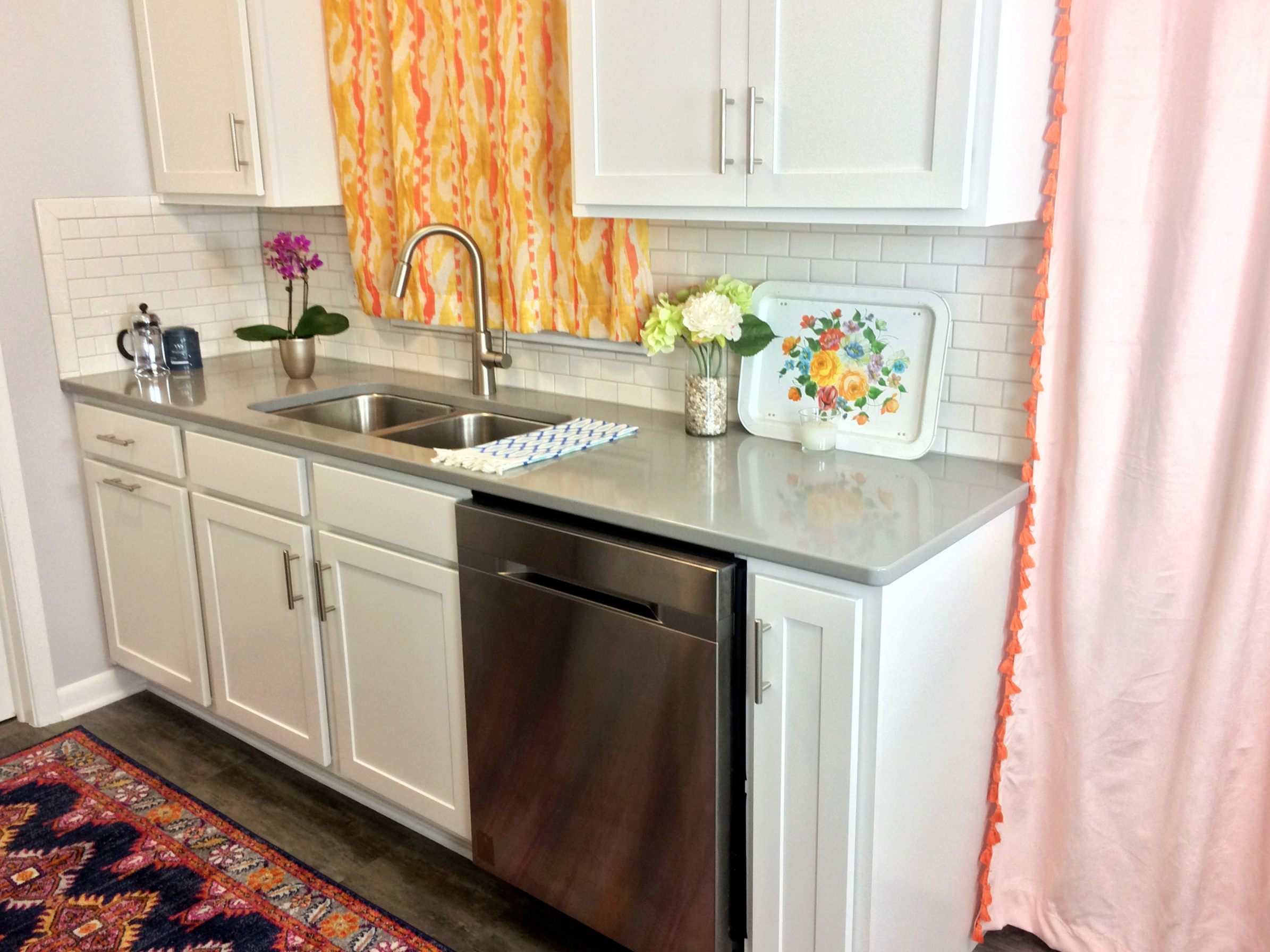 I love the pop of color these curtains give an otherwise stark and white kitchen.