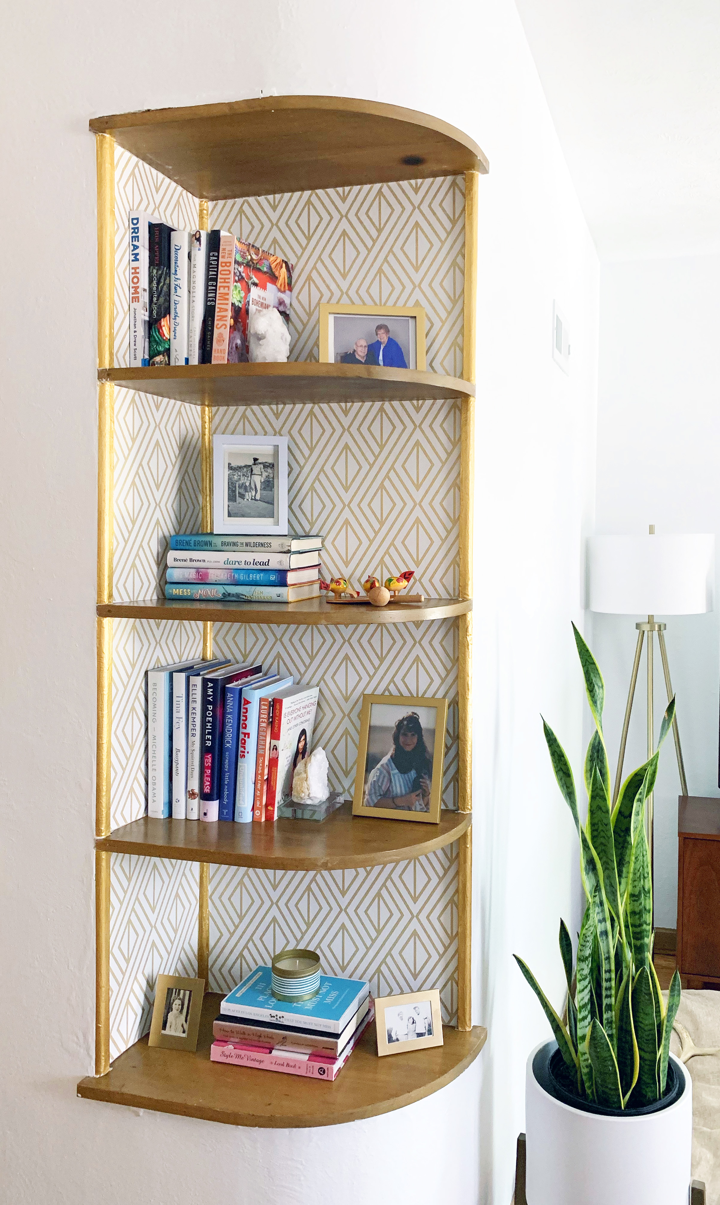 The finished bookshelf adds so much more character to the room!