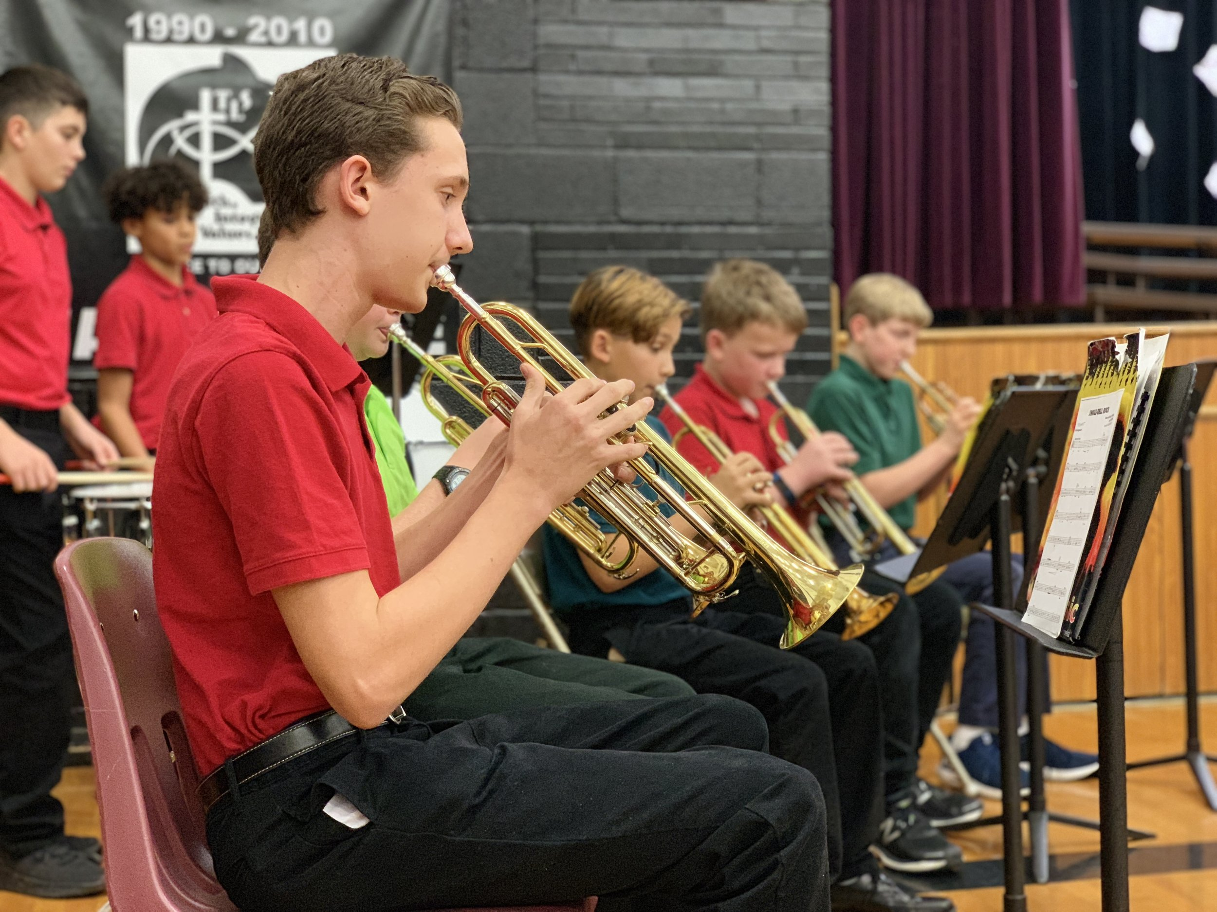 Arts and Athletics - Forming well rounded individuals means not only training the mind, but also training the body and teaching beauty. TLS offers opportunities for students to engage in the fine arts and athletics.
