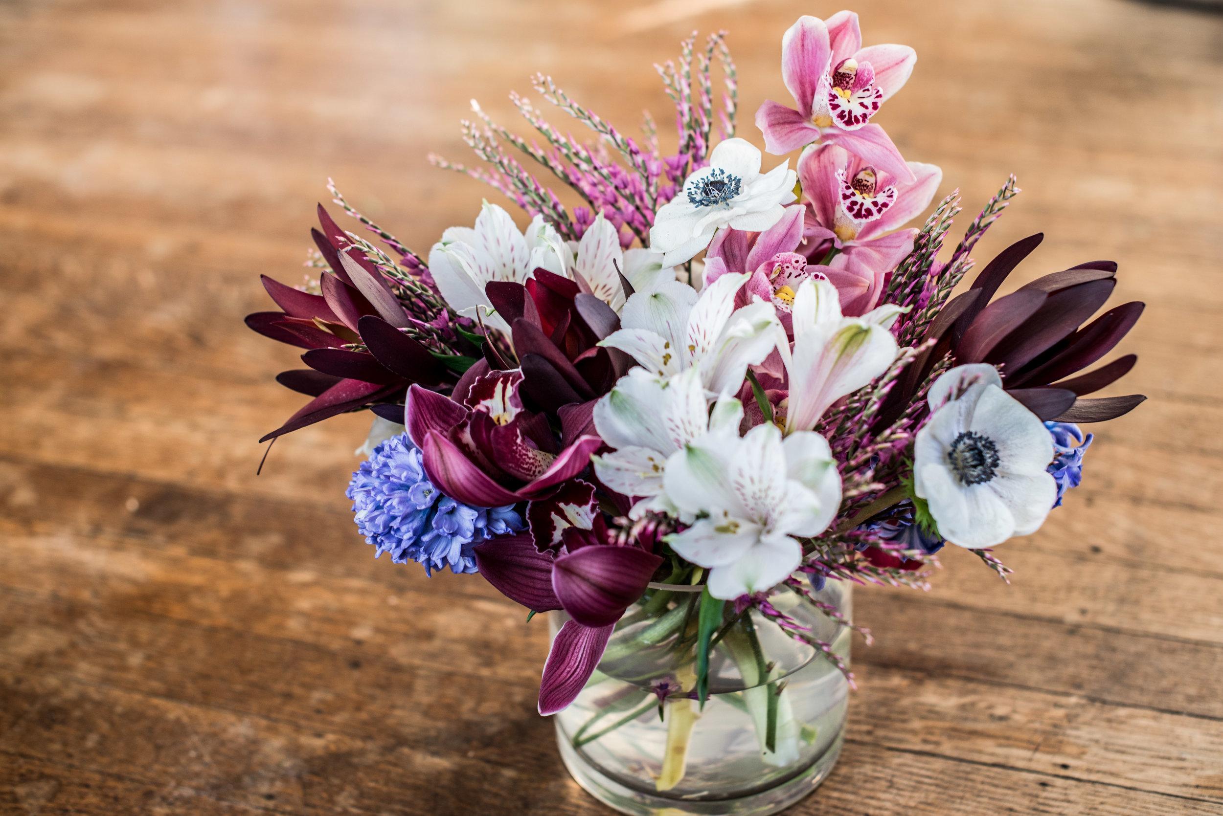 Ephemera Designs Floral Photography of white, pink, and dark magenta flower arrangement in vase