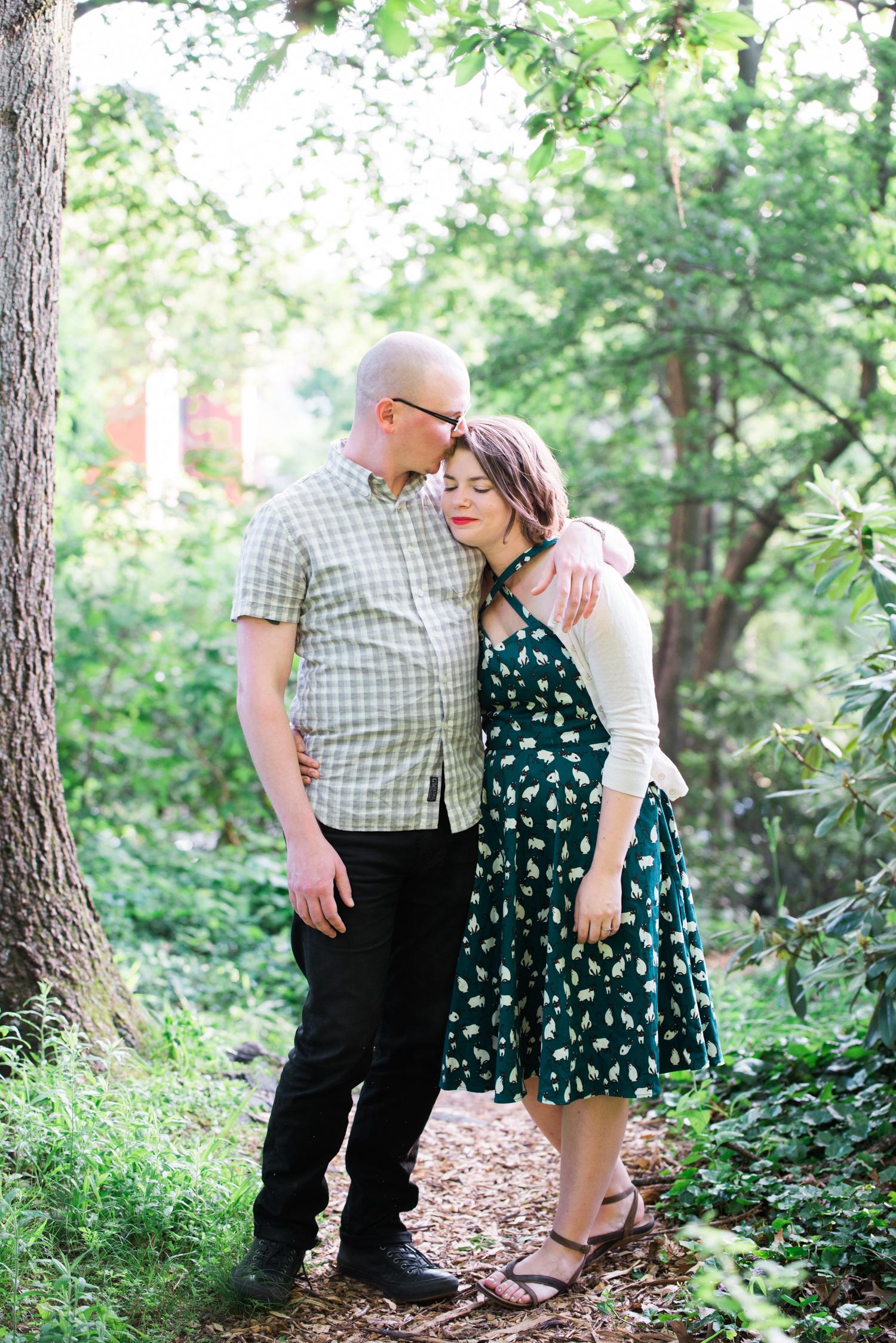 Ephemera Photography - Prospect Park RI Engagement man kissing fiancée's forehead