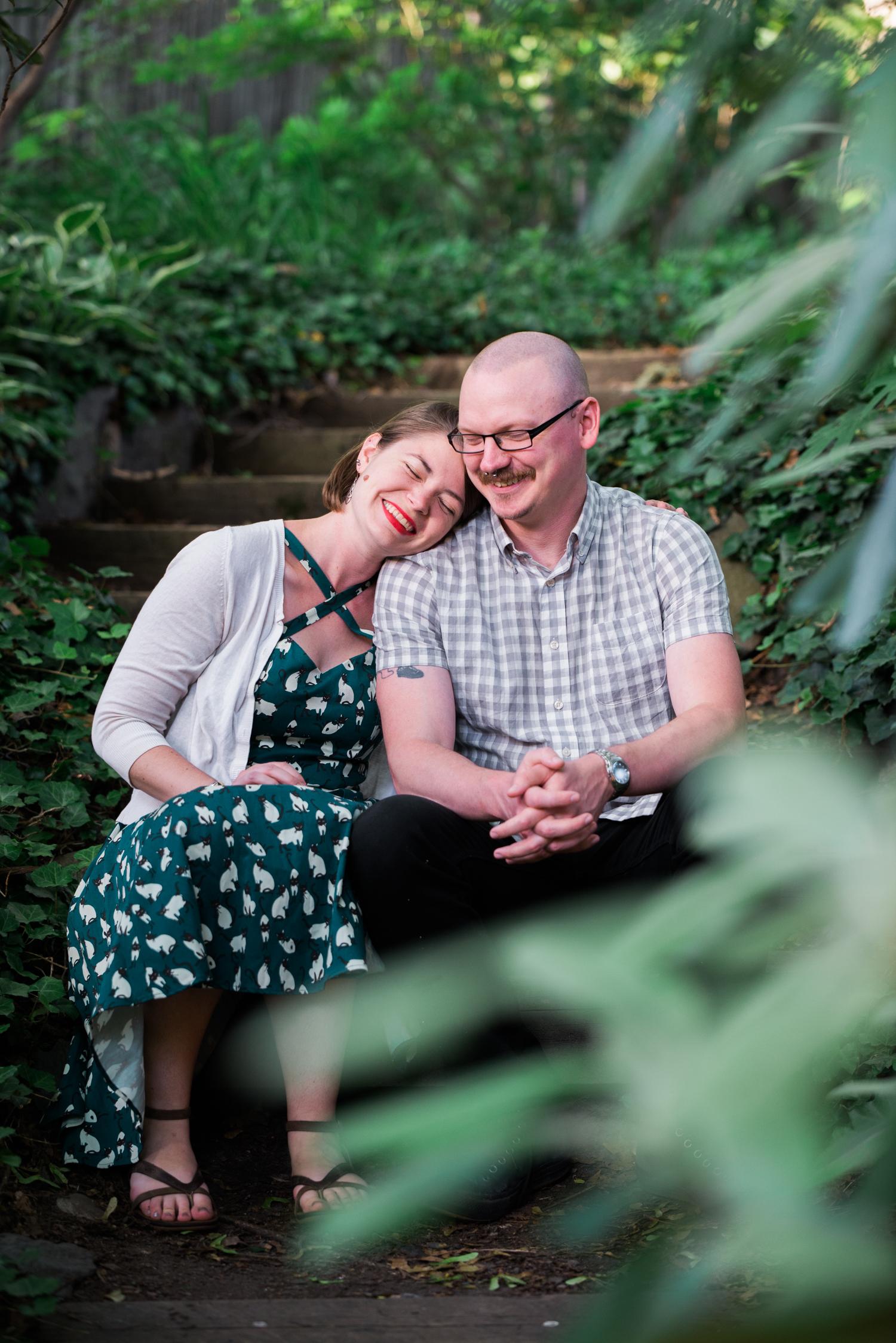 Ephemera Photography - Park Engagement photoshoot of couple sitting together on steps smiling