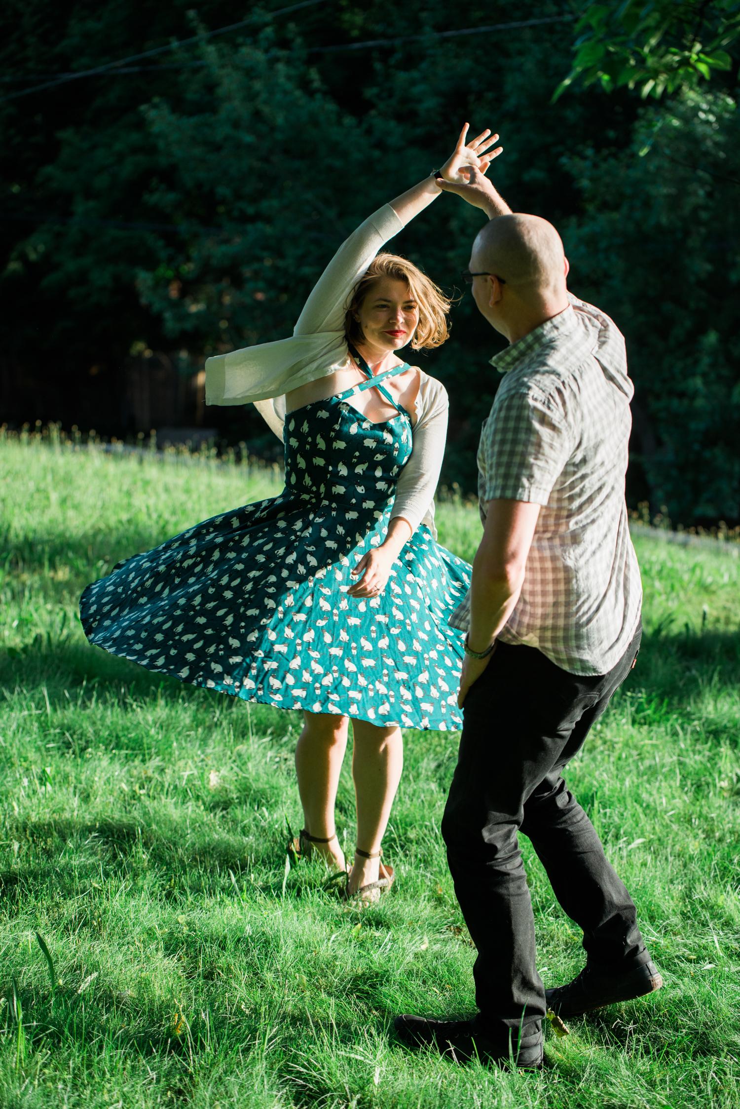 Ephemera Photography - Park Engagement photoshoot of couple dancing in grass