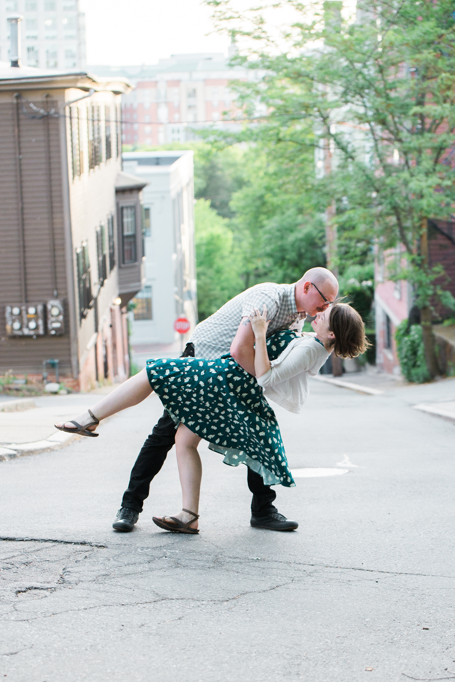 Ephemera Engagement Photography - man dips fiancée in middle of street
