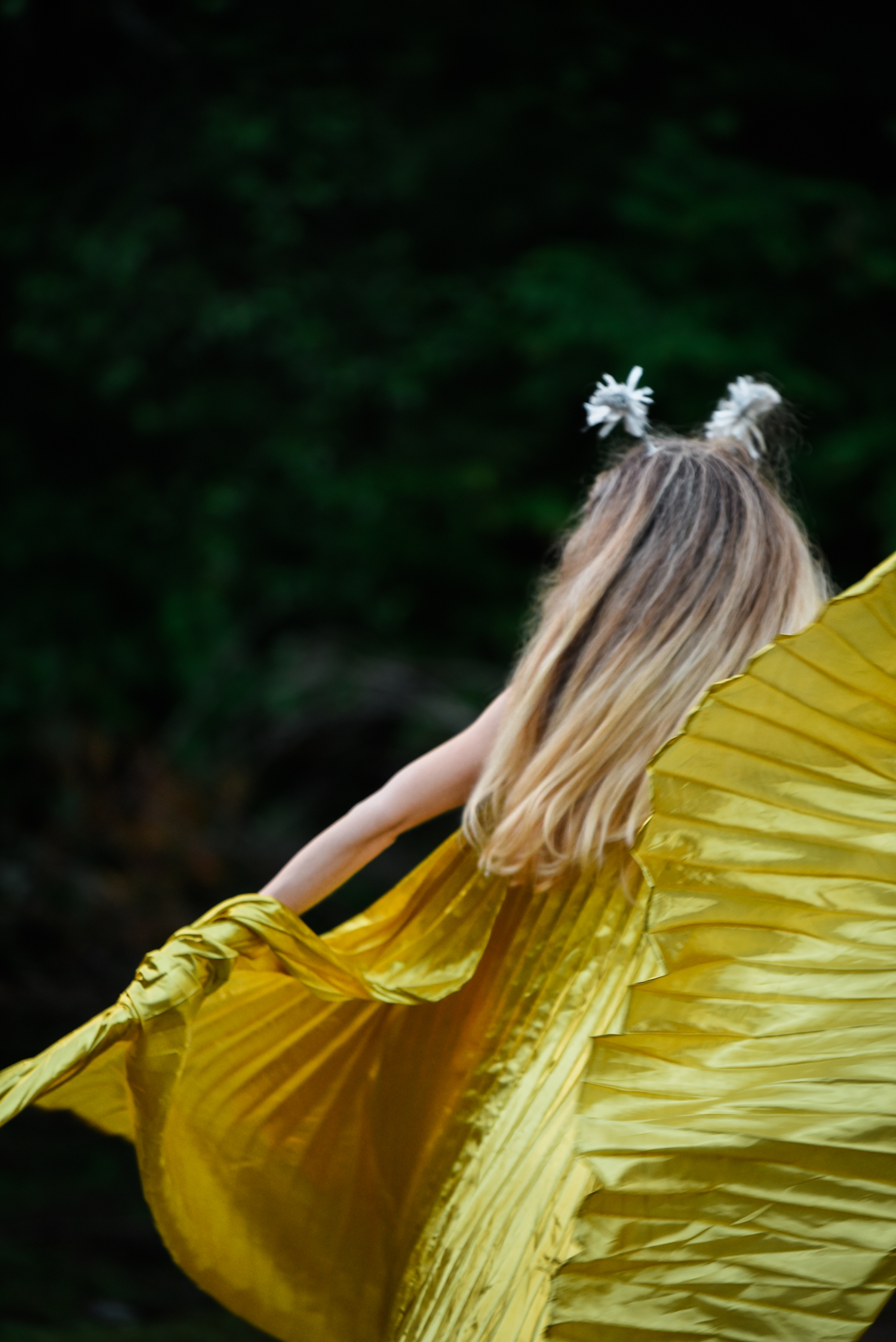 ephemera designs unifier festival photography of woman moving in flowing yellow dress