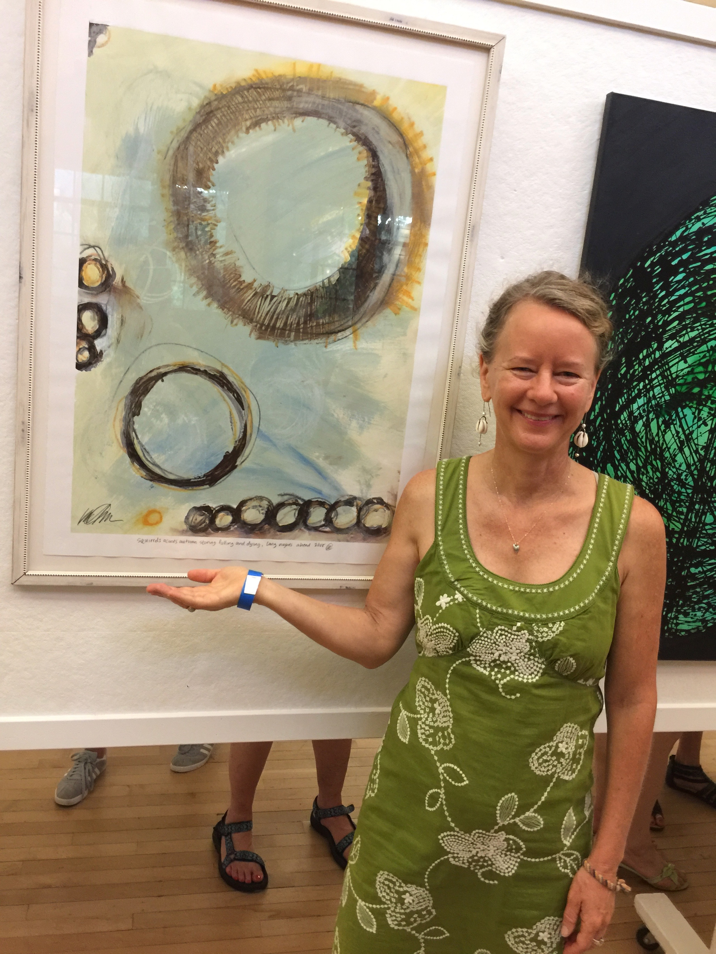 Karin Edgett in front of 'squirrels, acorns and fall, storing, falling and dying, long nights ahead' - SOLD at the 2017 Glen Echo Labor Day Art Show