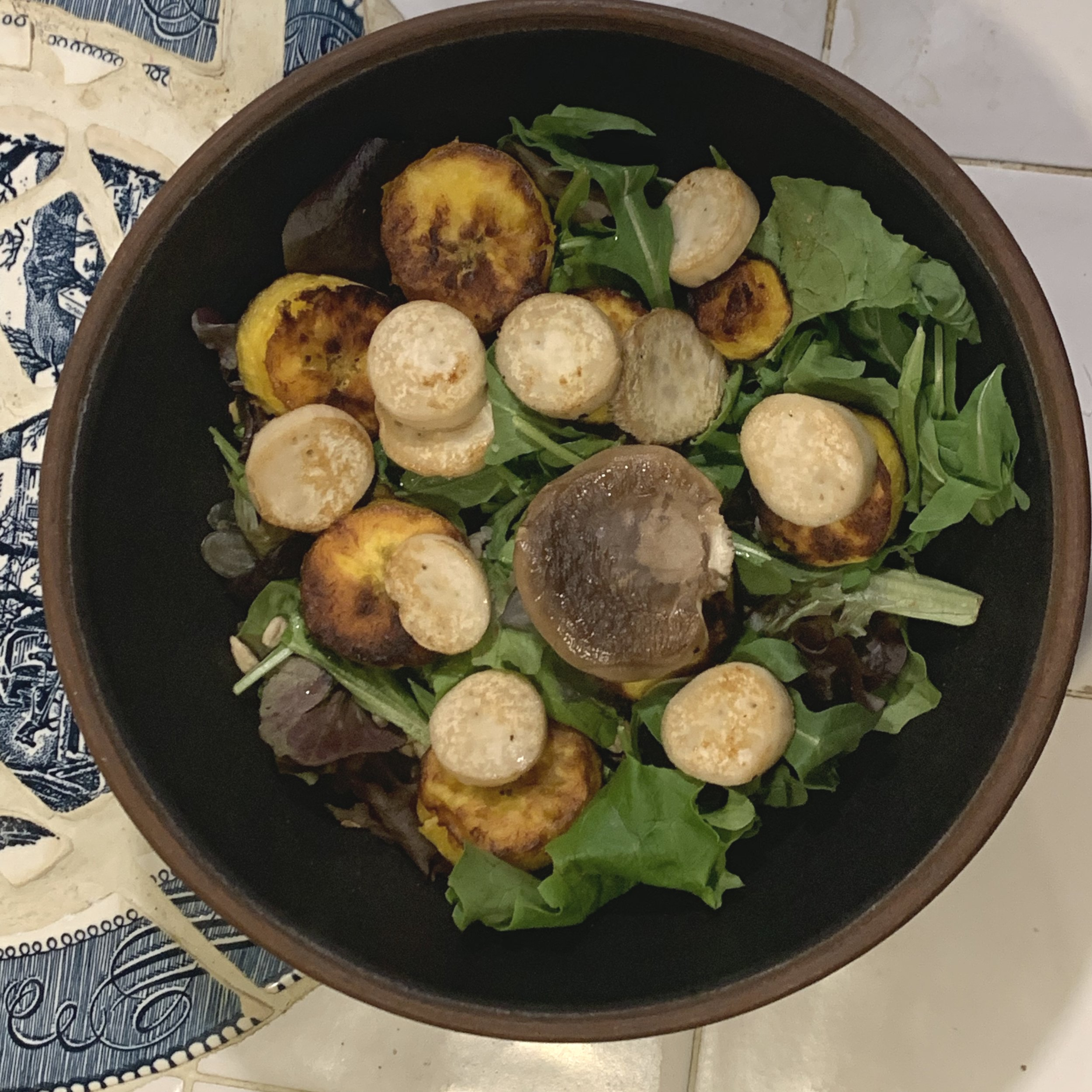 dry roasted trumped mushroom and plantain added to a spring mix salad