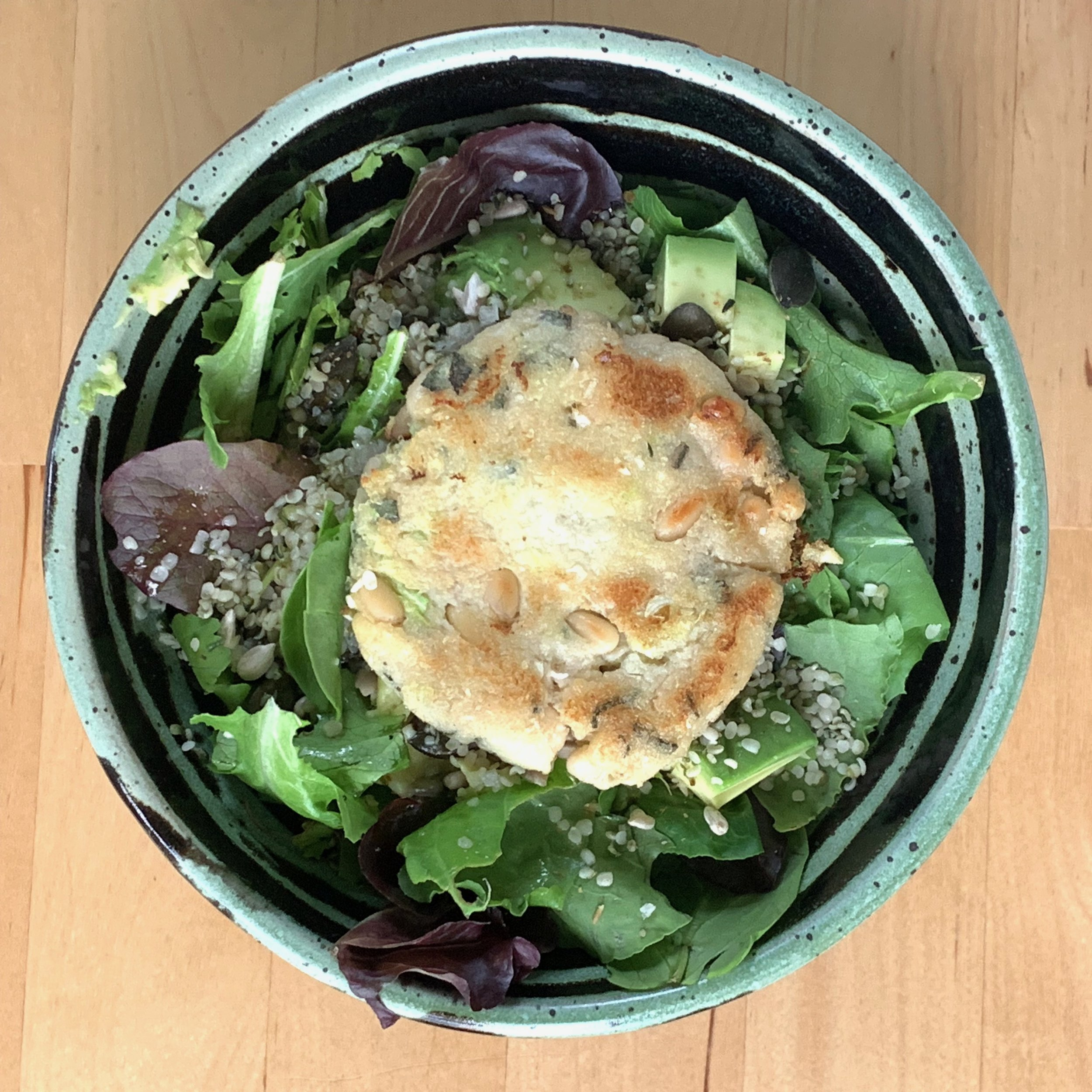 I like to eat my cabbage cakes without a bun, so I often toss it on top of a salad.