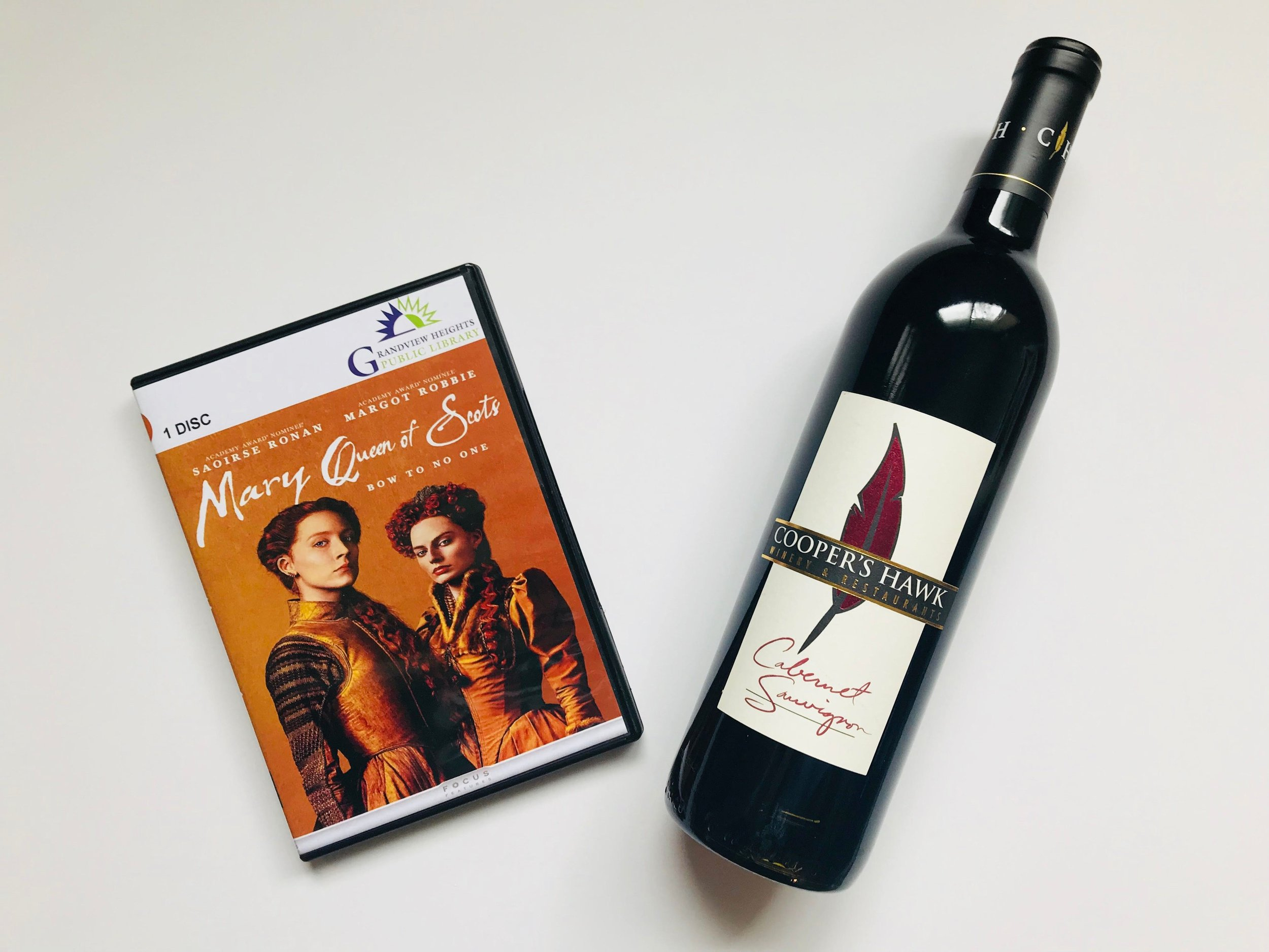 3. Friday Night In - Budget-friendly date night in - a library movie rental, Mary Queen of Scots, and red wine from our favorite restaurant.