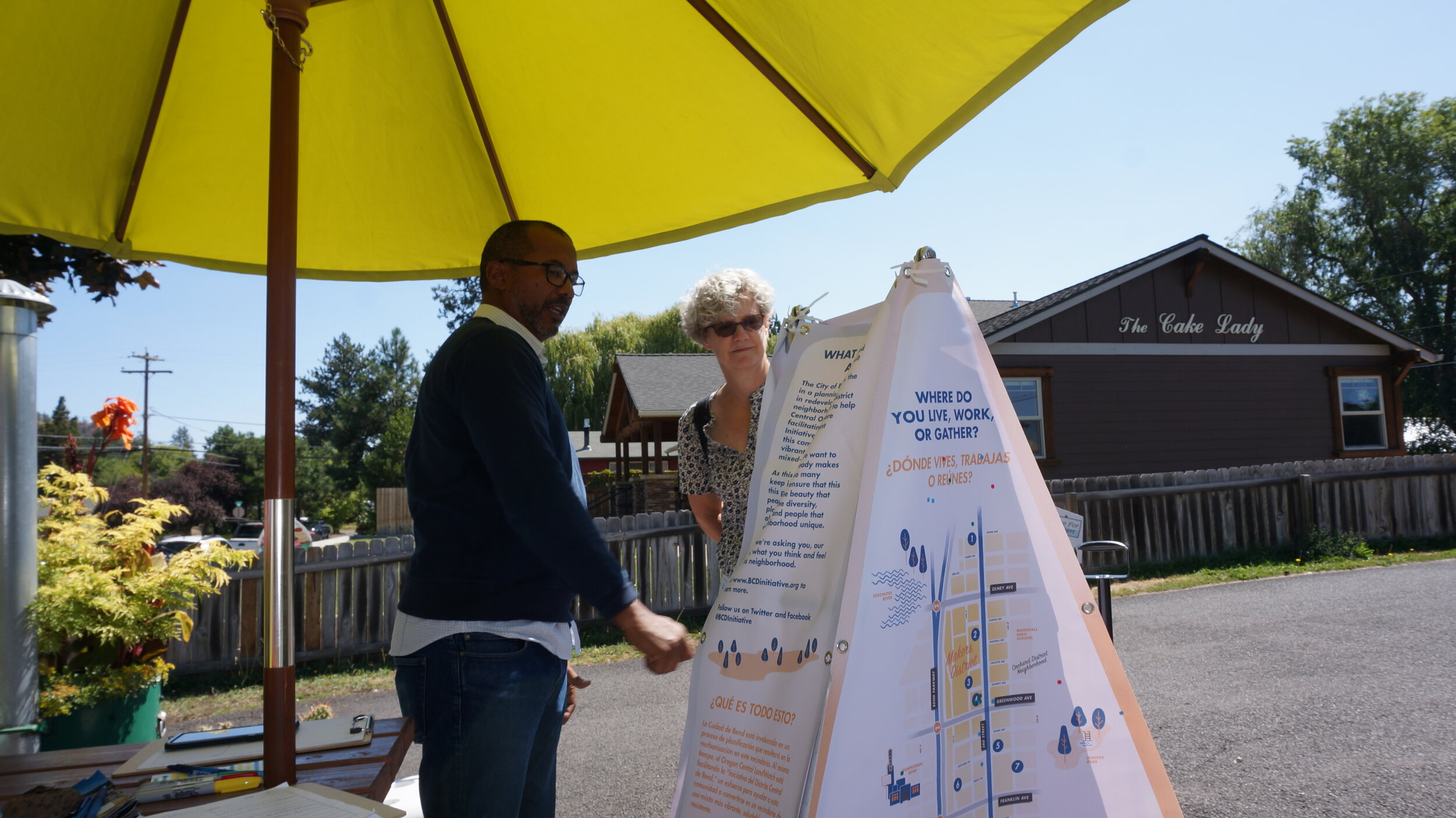 The engagement tool is custom made out of a flyer wagon shell with an added metal frame and tent-shaped unit with four panels that serve as the starting point for substantive conversations. It includes a map, pockets to collect sensory information, and asks for one-word to describe the area.