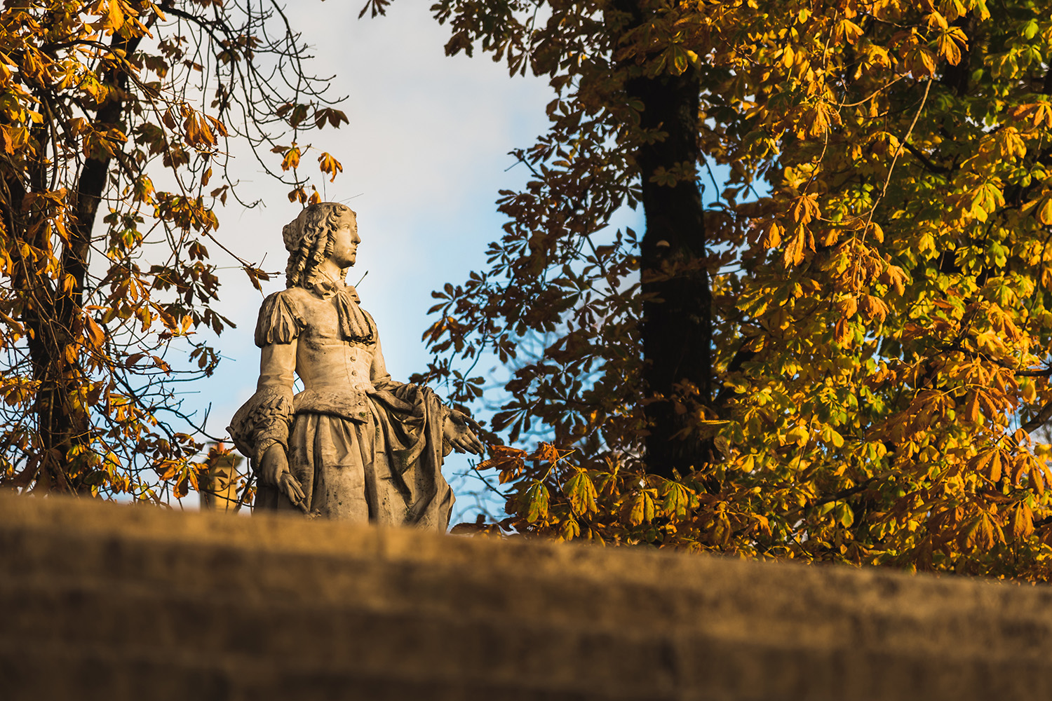 Statue watching the autumn