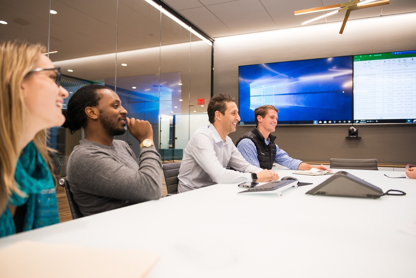 Four Liquidnet employees at conference table in Liquidnet Virtual High Touch and algorithmic trading meeting