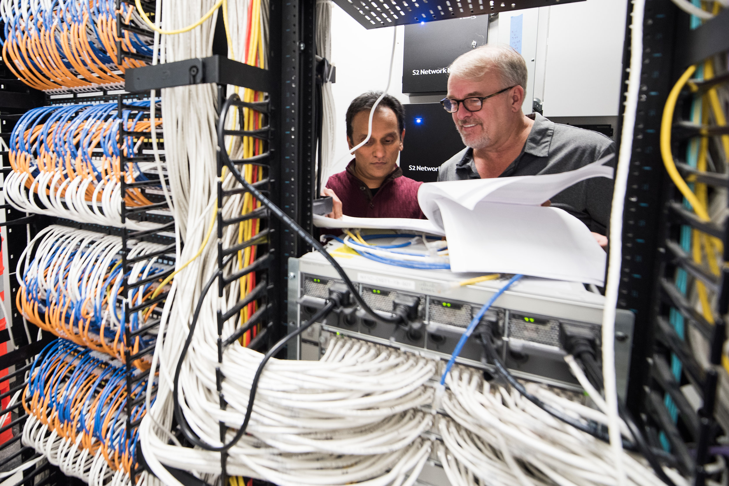 Two Liquidnet infosec experts work in the server room