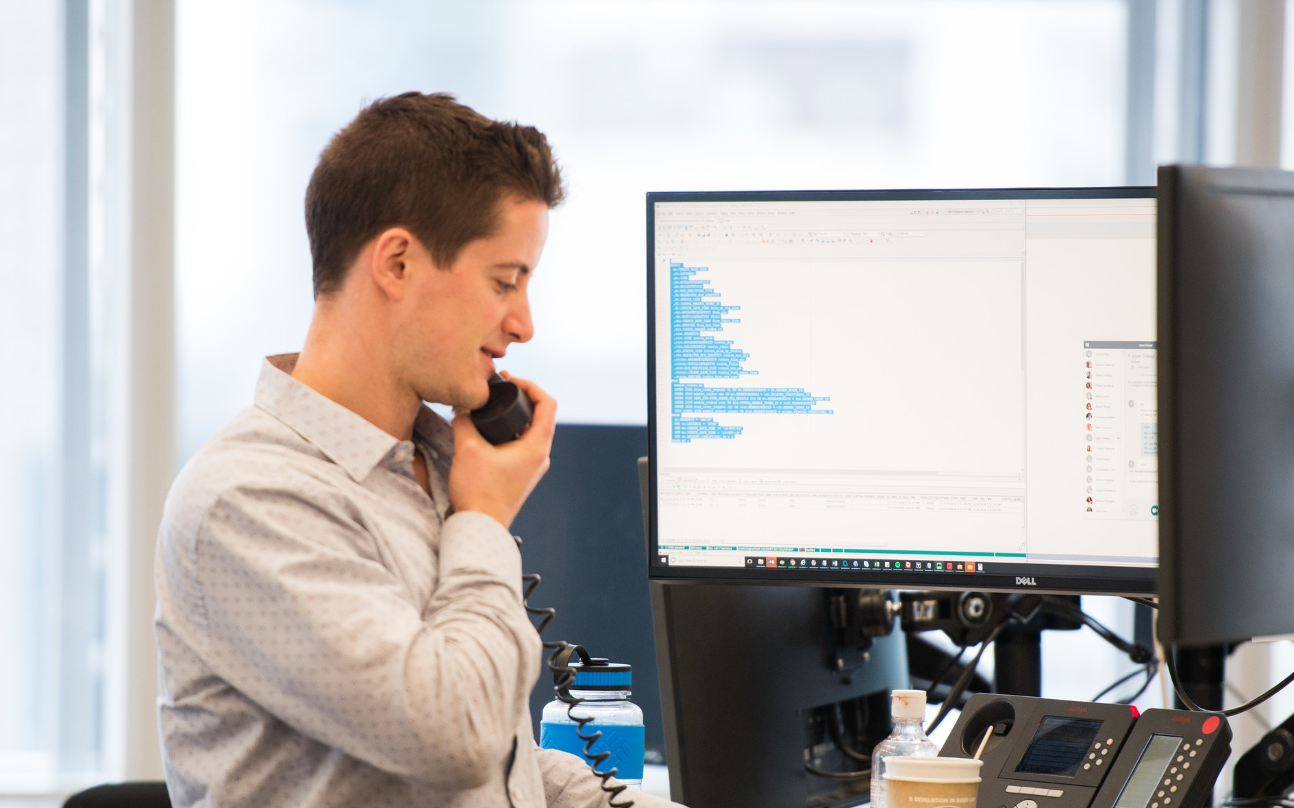Liquidnet employee on phone providing commission management services